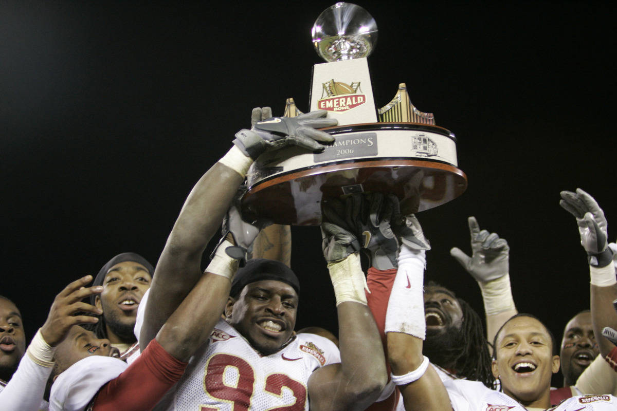 Florida State players celebrate as the hoist the winner's trophy at the end of a 44-27 win over UCLA in the Emerald Bowl in San Francisco, Wednesday, Dec. 27, 2006.(AP Photo/Marcio Jose Sanchez)