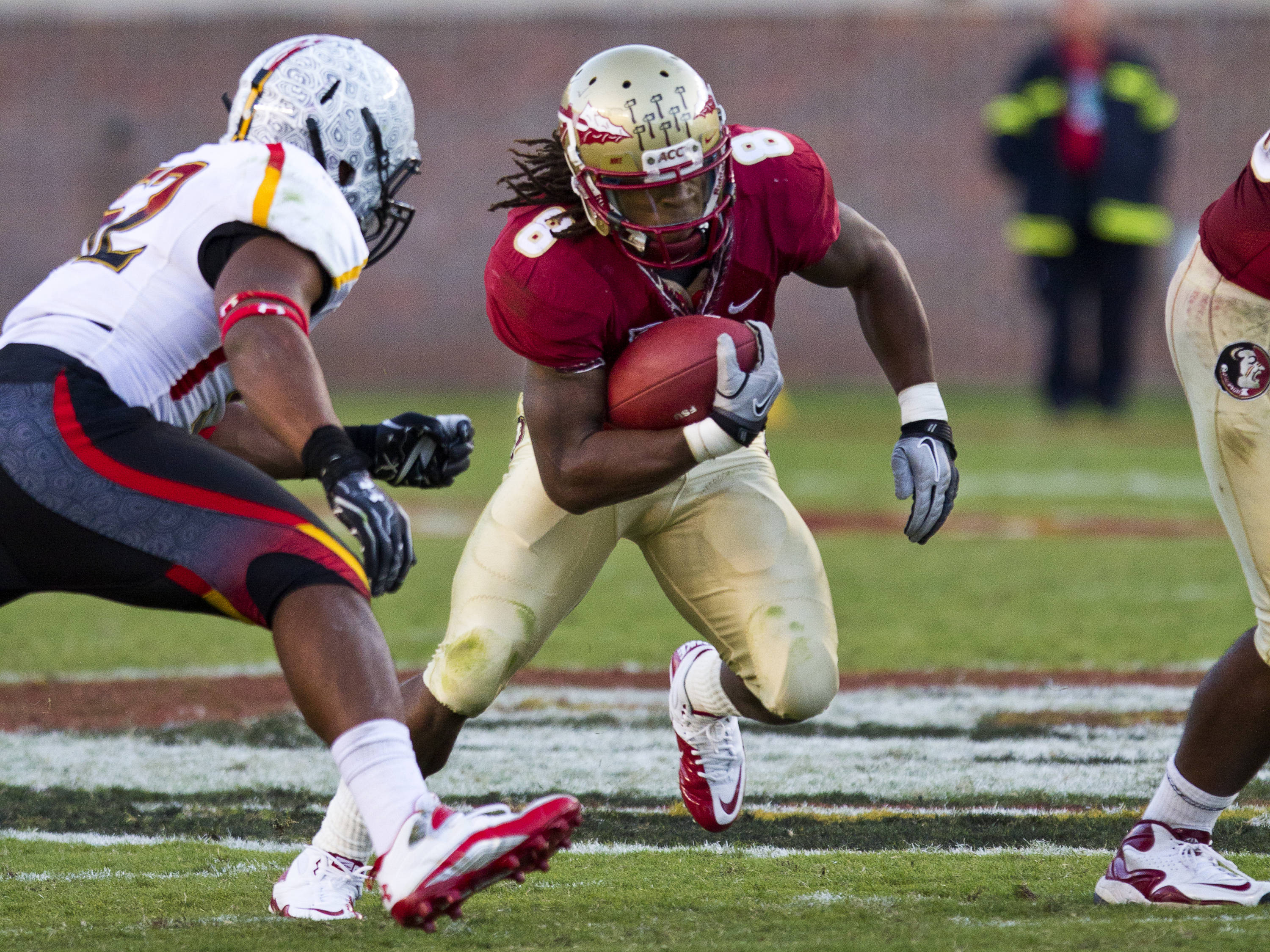 Devonta Freeman (8) carries the ball past a Maryland defender during the football game against Maryland in Tallahassee, Florida on October 22, 2011.