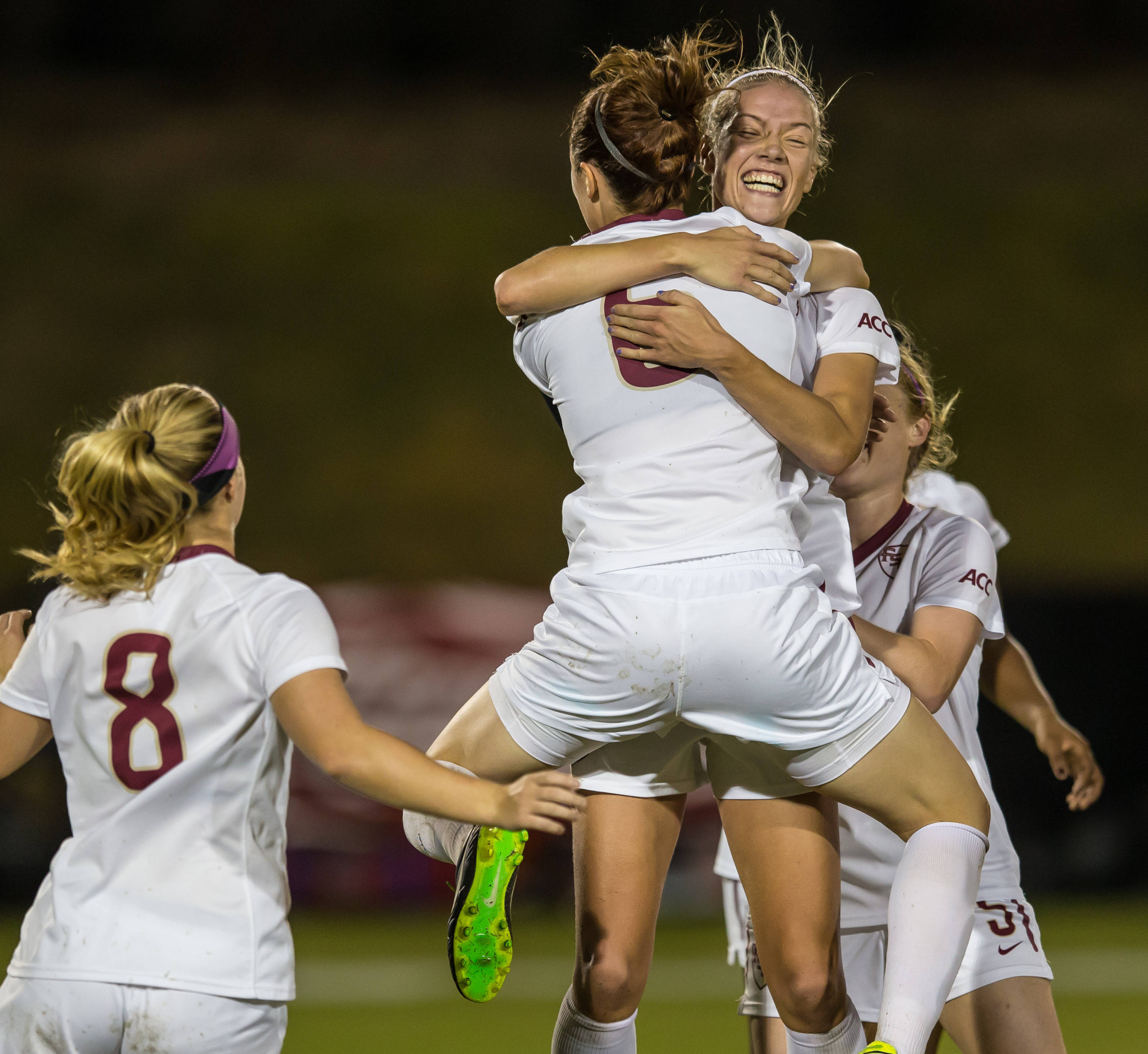 Dagny Brynjarsdottir (7)and Megan Campbell (6) celebrate Dagny's game clinching goal.  The score was set up by a crossing pass from Campbell.