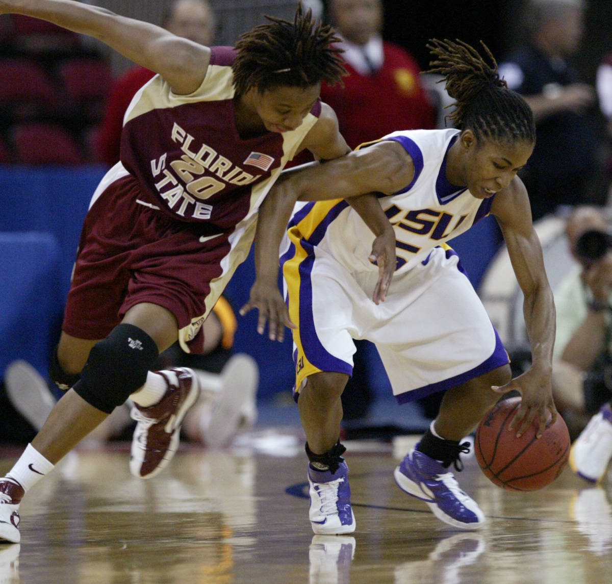 Florida State's Tanae Davis-Cain tries to steal the ball from Louisiana State's Erica White during the first half of a regional semifinal in the NCAA women's basketball tournament in Fresno, Calif., Saturday, March 24, 2007. (AP Photo/Gary Kazanjian)