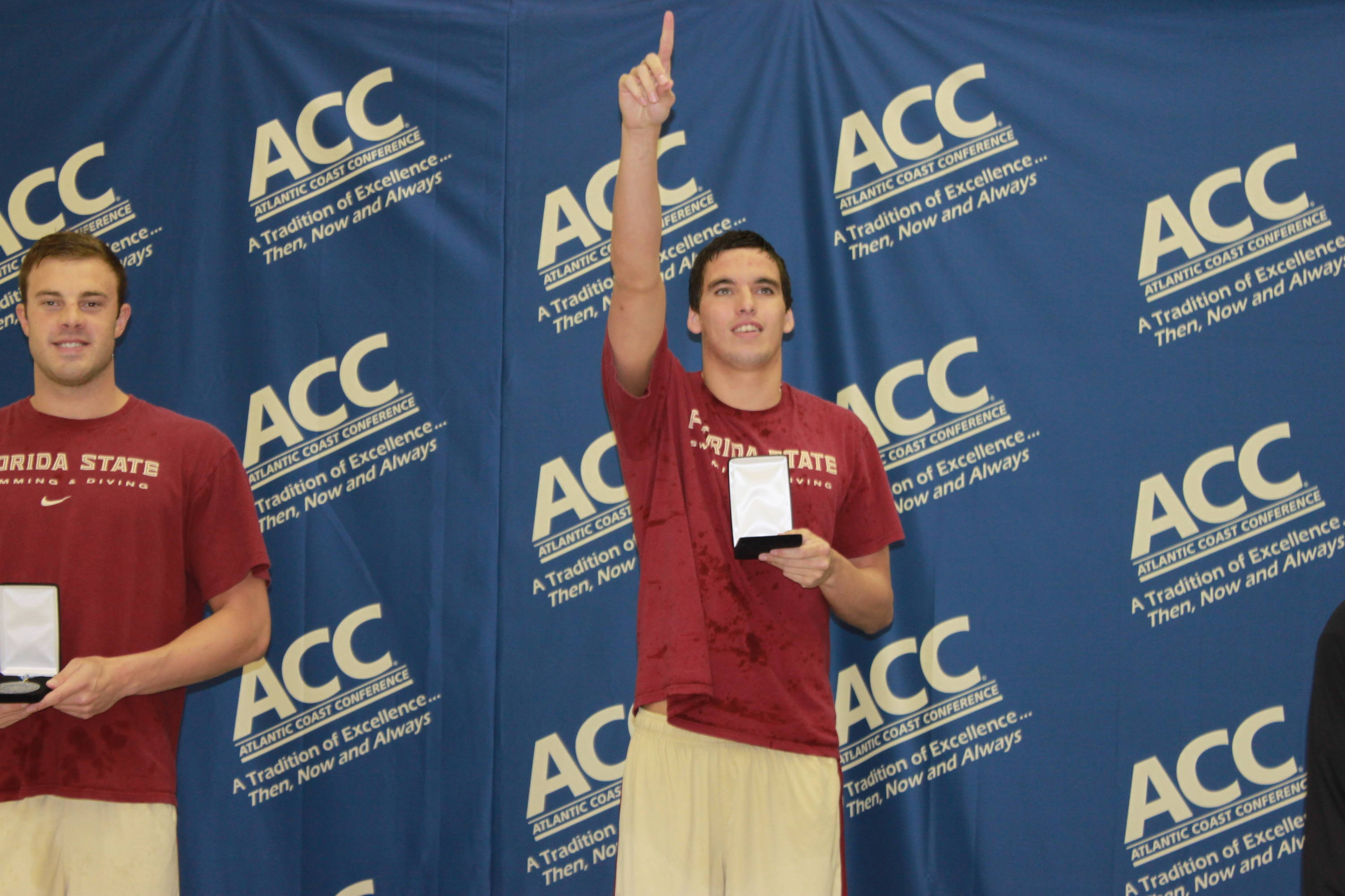 Rob Holderness gets his medal after winning the 100 breast