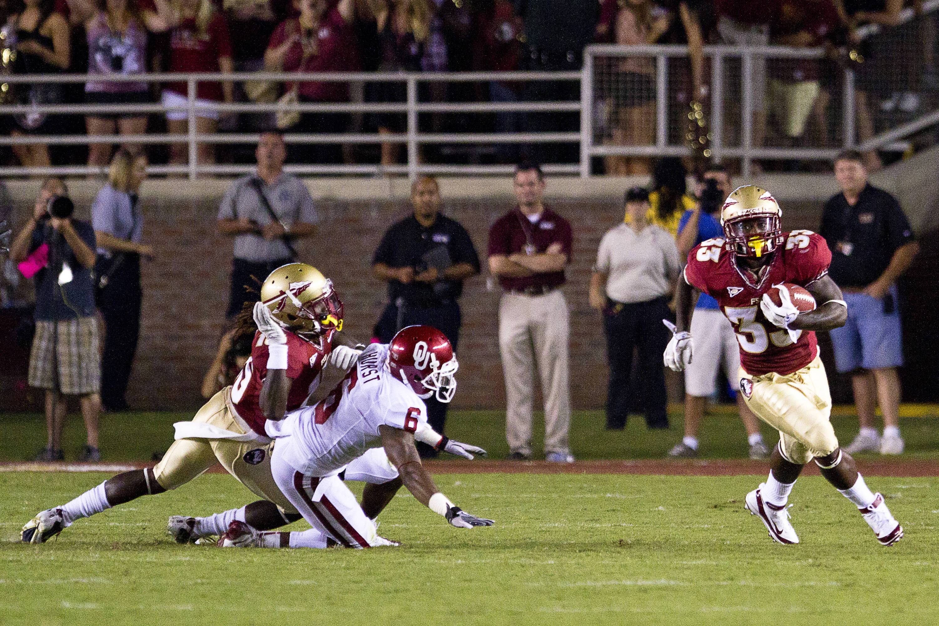 Ty Jones (33) carries the ball down field during the game against Oklahoma on September 17, 2011.
