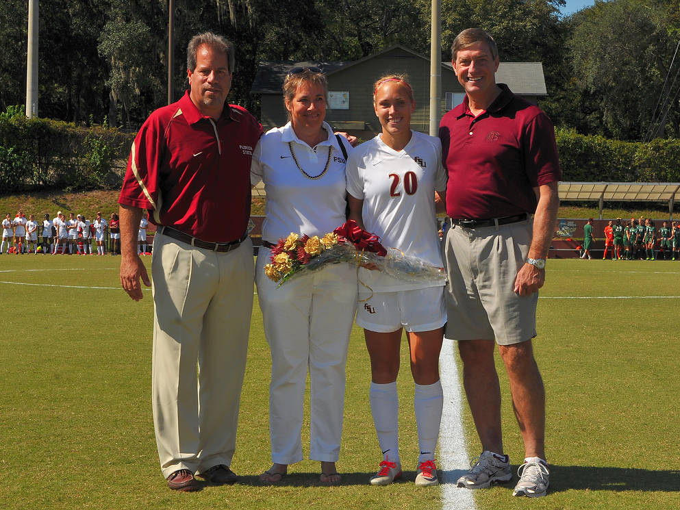Head coach Mark Krikorian and Director of Athletics Randy Spetman with Janice Cayman and her mom on senior day.