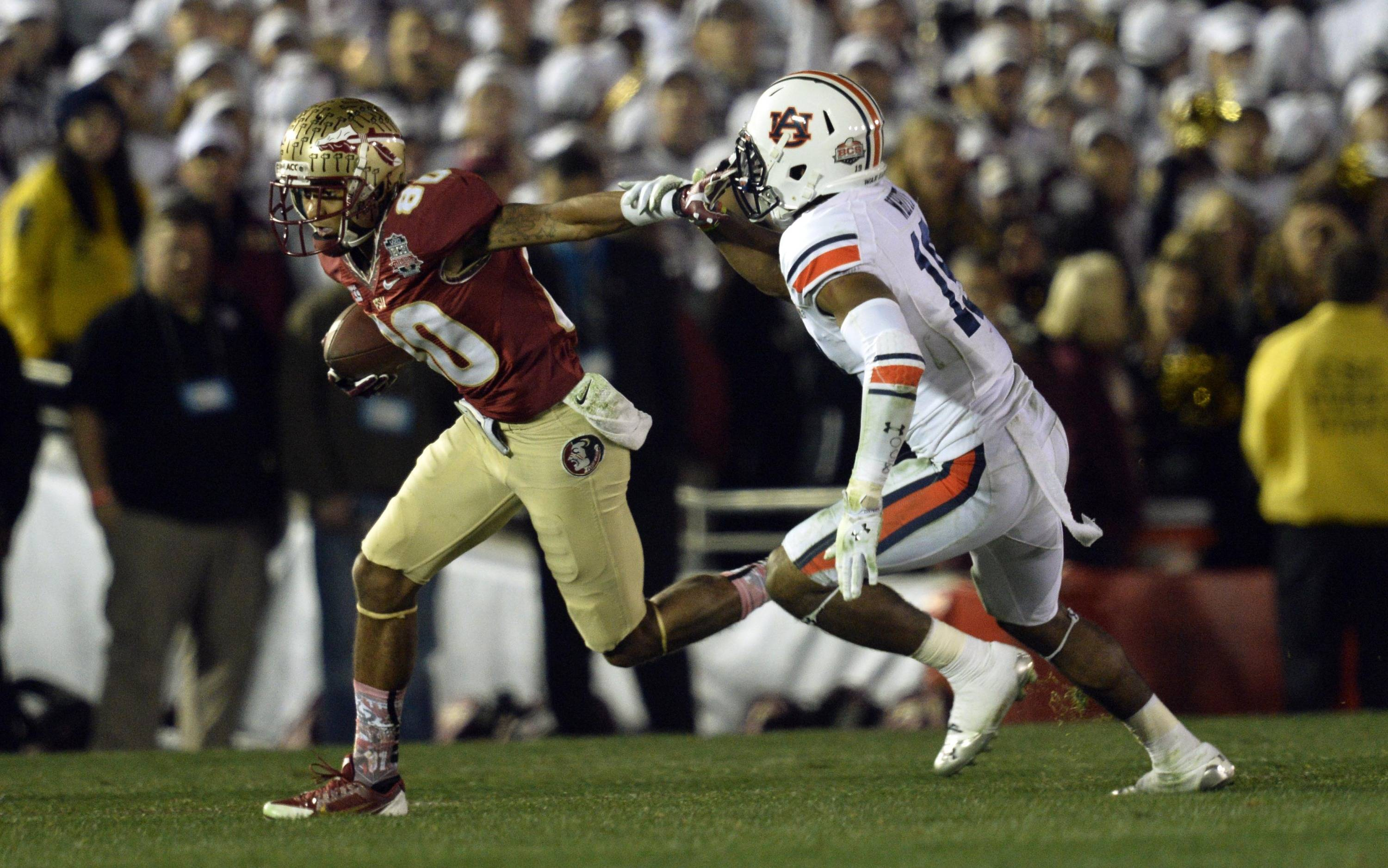 Jan 6, 2014; Pasadena, CA, USA; Florida State Seminoles wide receiver Rashad Greene (80) tries to get past Auburn Tigers defensive back Ryan White (19) during the second half of the 2014 BCS National Championship game at the Rose Bowl.  Mandatory Credit: Robert Hanashiro-USA TODAY Sports