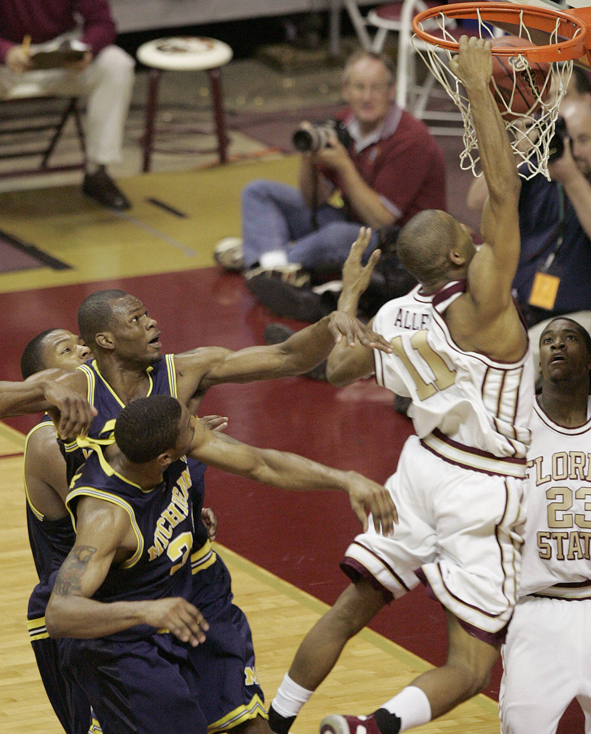 Florida State's Jerel Allen dunks in front of Michigan defenders. (AP Photo/Steve Cannon)