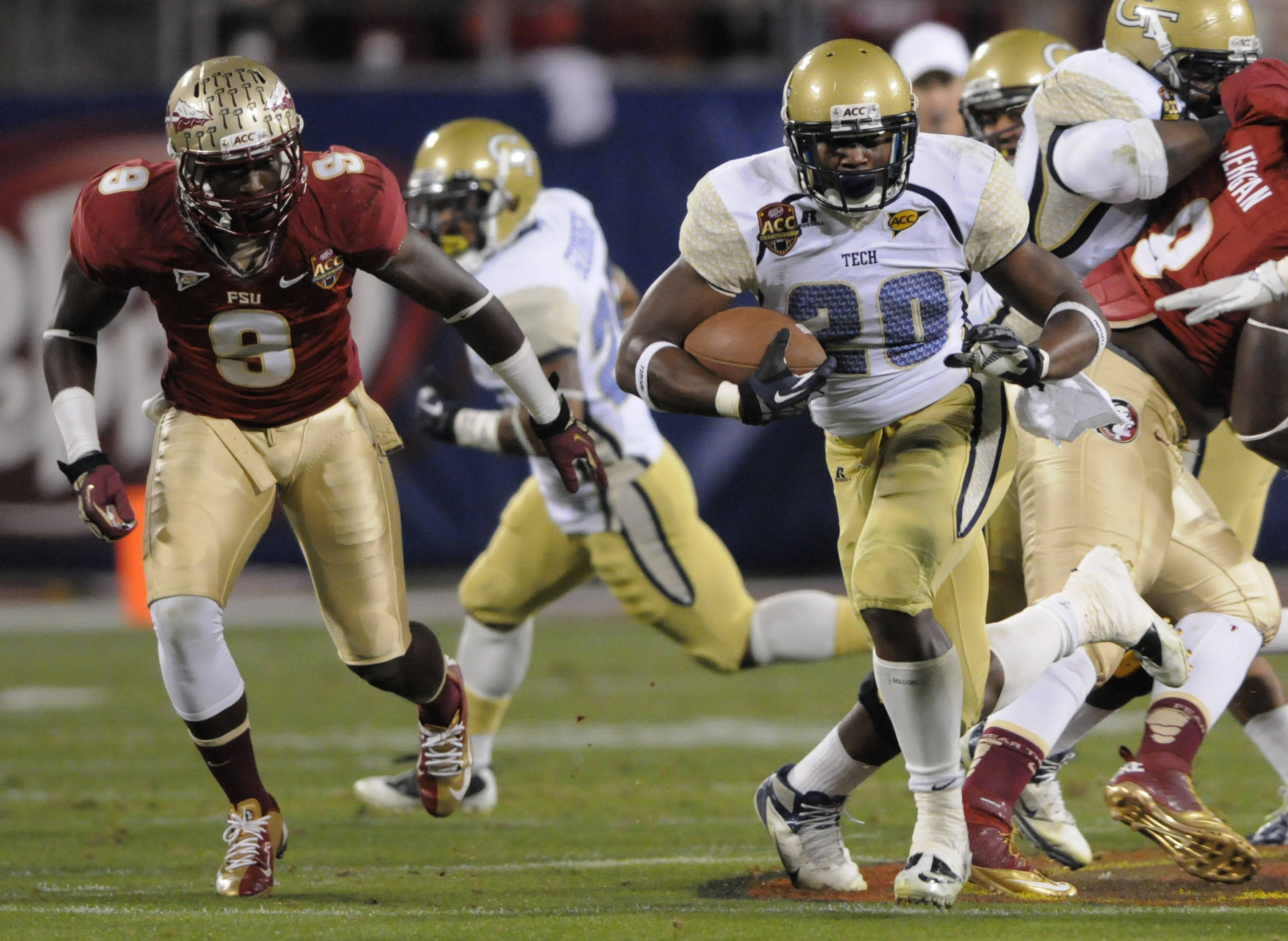 Georgia Tech's David Sims (20) runs past Florida State's Timmy Jernigan (8) during the first half of the ACC Championship college football game in Charlotte, N.C., Saturday, Dec. 1, 2012. (AP Photo/Mike McCarn)