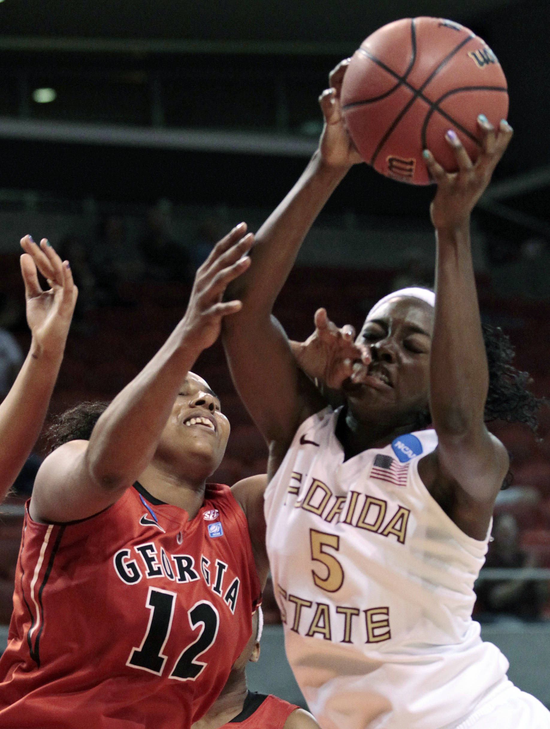 Florida State's Christian Hunnicutt (5) is fouled by Georgia's Courtney Ward (12)  in the first half of a second-round NCAA women's college basketball tournament game at Auburn Arena in Auburn, Ala., Tuesday, March 22, 2011.  (AP Photo/Dave Martin)