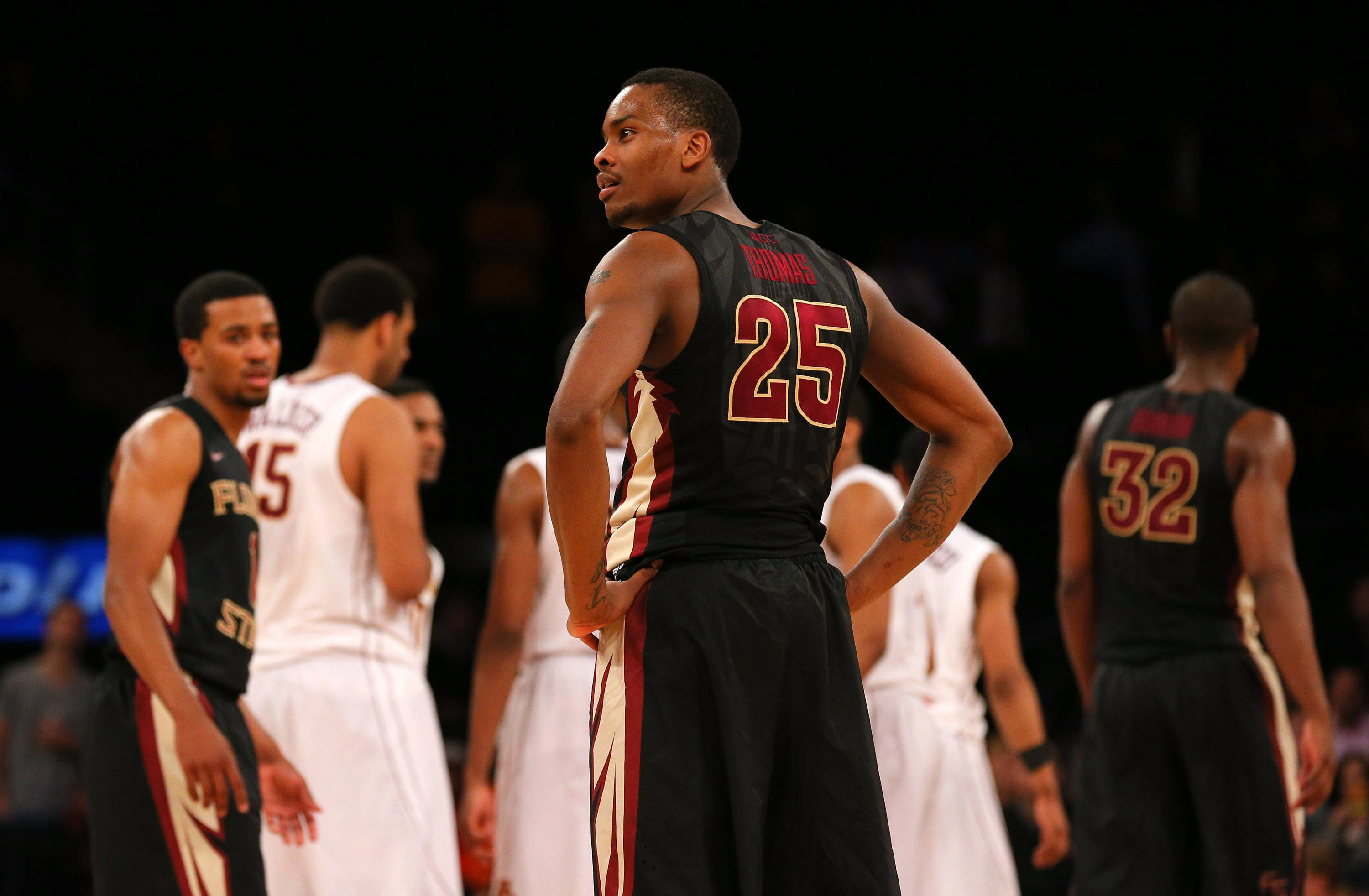 Apr 1, 2014; New York, NY, USA; Florida State Seminoles guard Aaron Thomas (25) reacts to being called for a foul against the Minnesota Golden Gophers during the second half at Madison Square Garden. The Minnesota Golden Gophers defeated the Florida State Seminoles 67-64 in overtime. Mandatory Credit: Adam Hunger-USA TODAY Sports