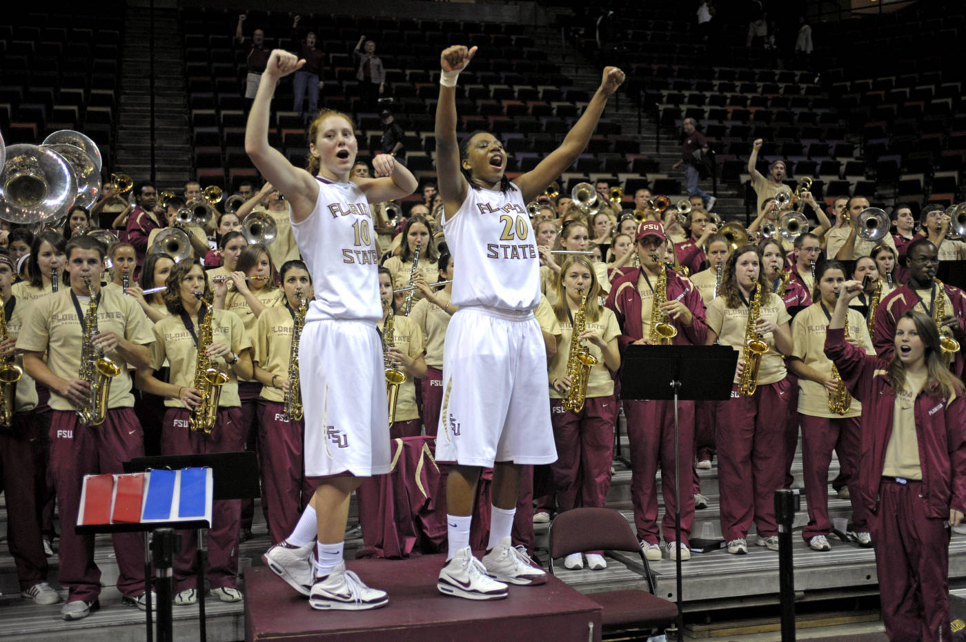 Mara Freshour and Tanae Davis-Cain celebrate their final game with the women's basketball team.