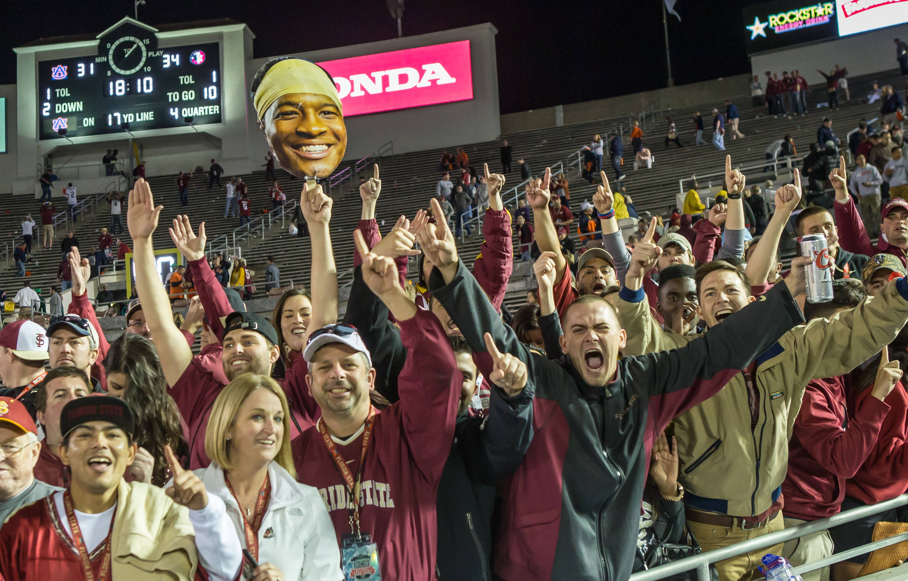 Jubilant Seminole fans celebrate the title with the Rose Bowl scoreboard in the background.
