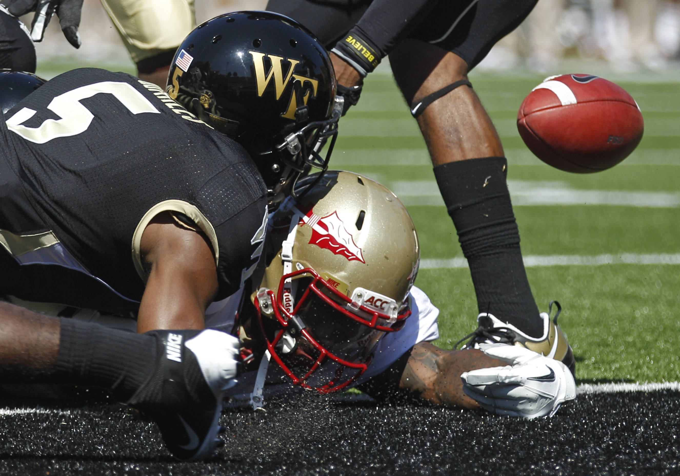 Florida State's James Wilder Jr., right, loses the ball after crossing the goal line for a touchdown as Wake Forest's Cyhl Quarles, left, defends during the first quarter of a NCAA college football game in Winston-Salem, N.C., Saturday, Oct. 8, 2011. (AP Photo/Chuck Burton)
