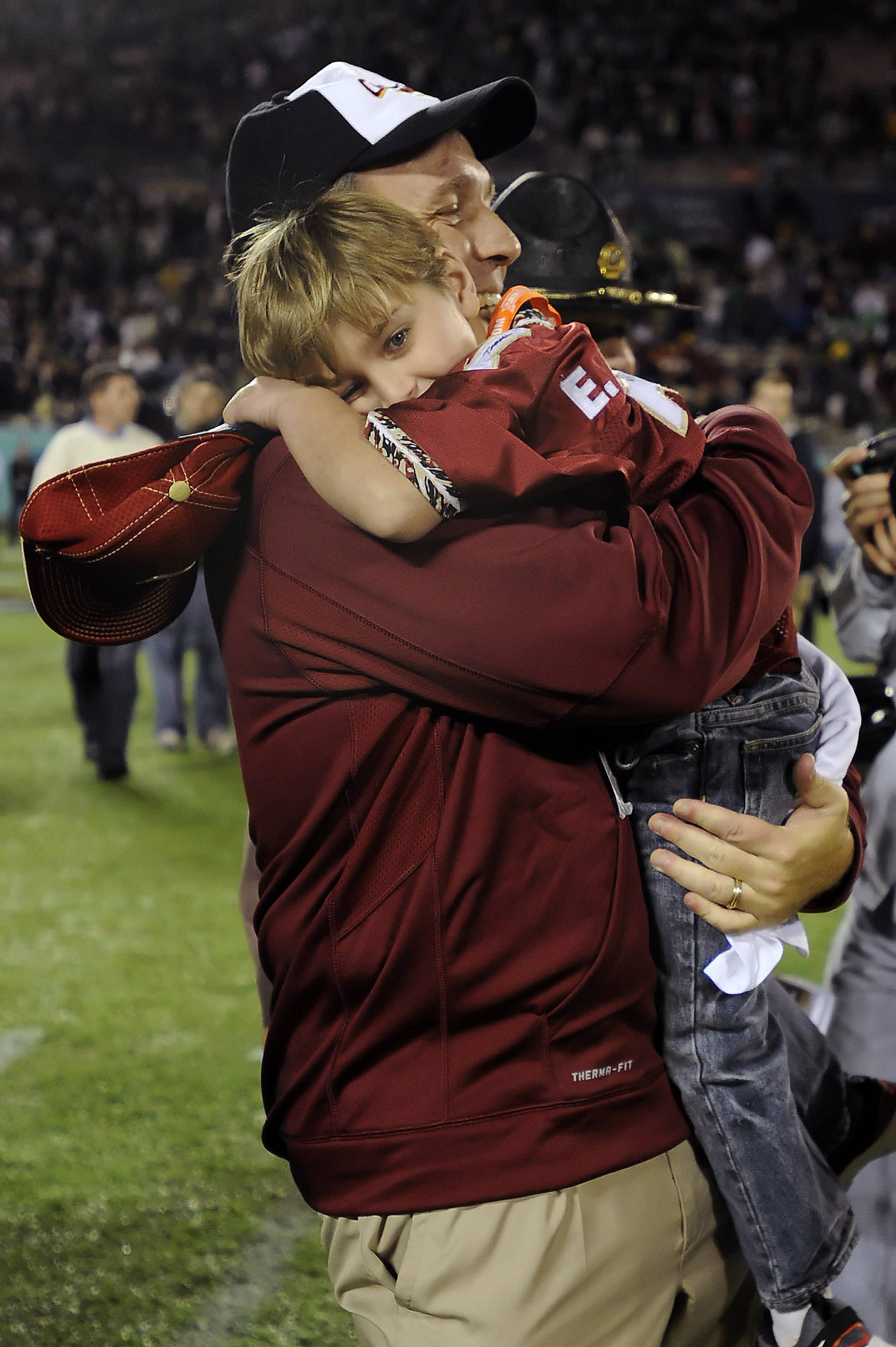 Jimbo Fisher celebrates with son Ethan after Florida State's victory in the Champs Sports Bowl