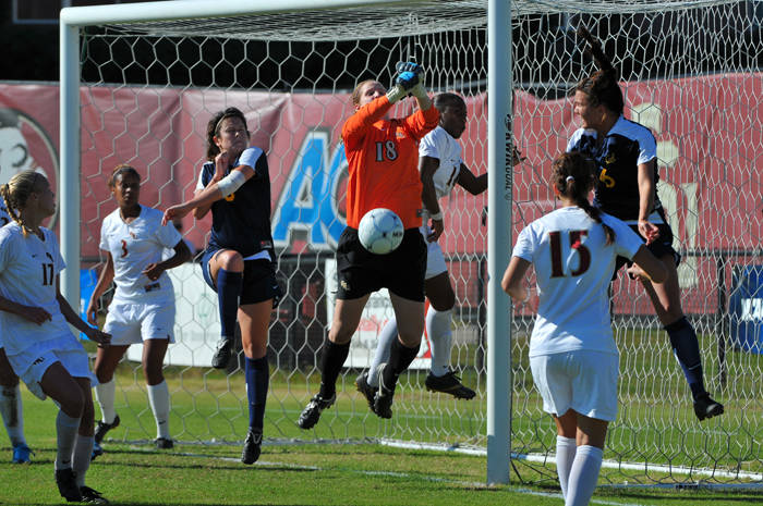 Erin McNulty punches away a Cal corner on Sunday afternoon.