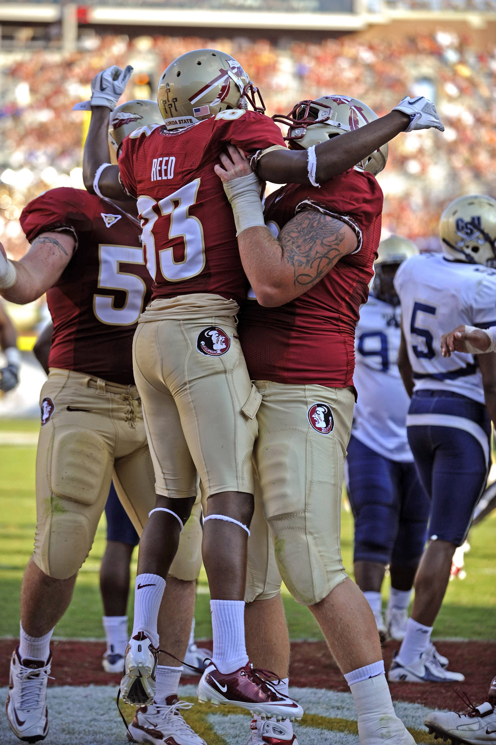 Bert Reed Celebrates with his lineman after scoring a touchdown