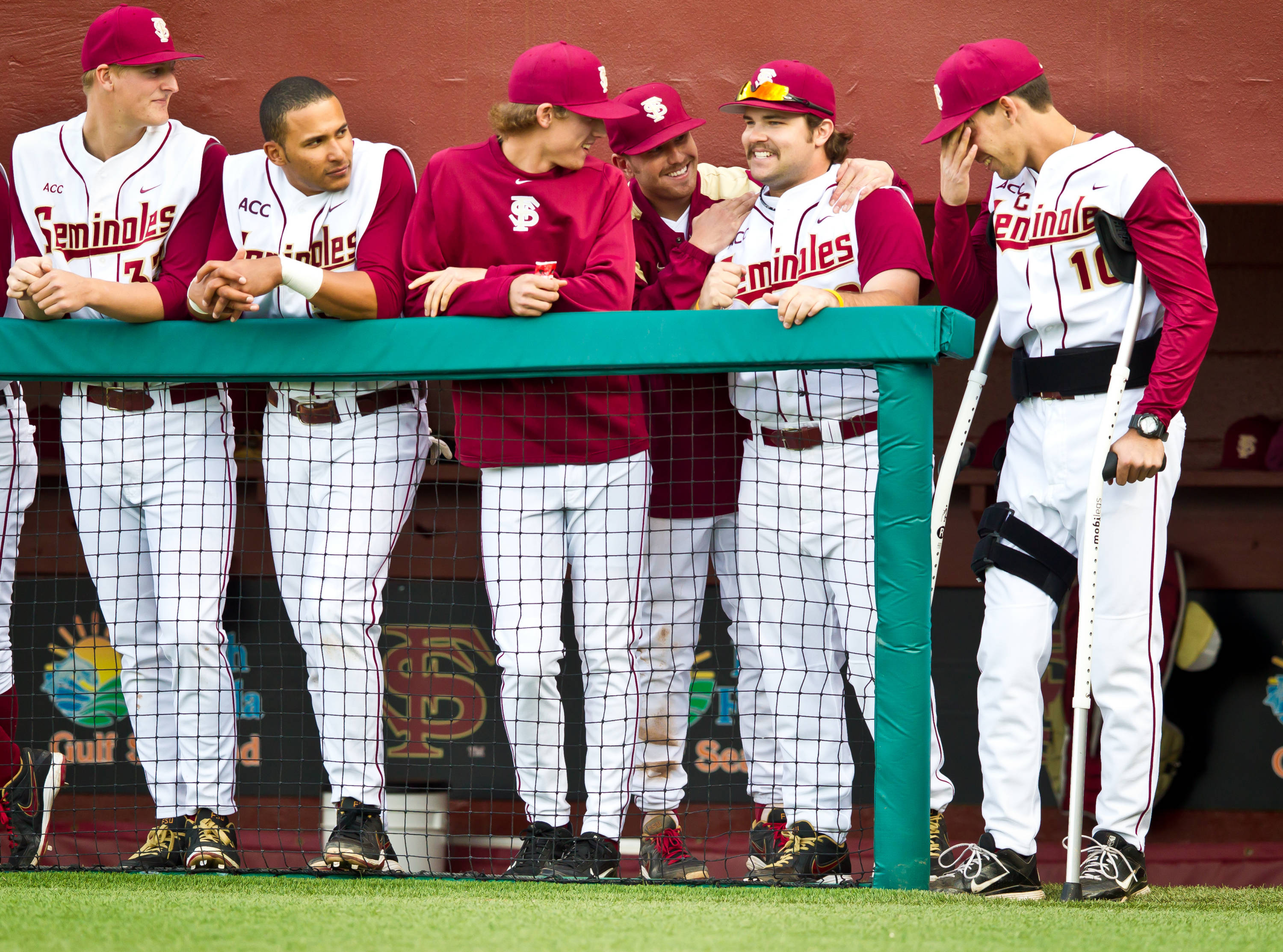 The Seminoles congratulate Scott Sitz on making his first collegiate plate appearance on Wednesday.