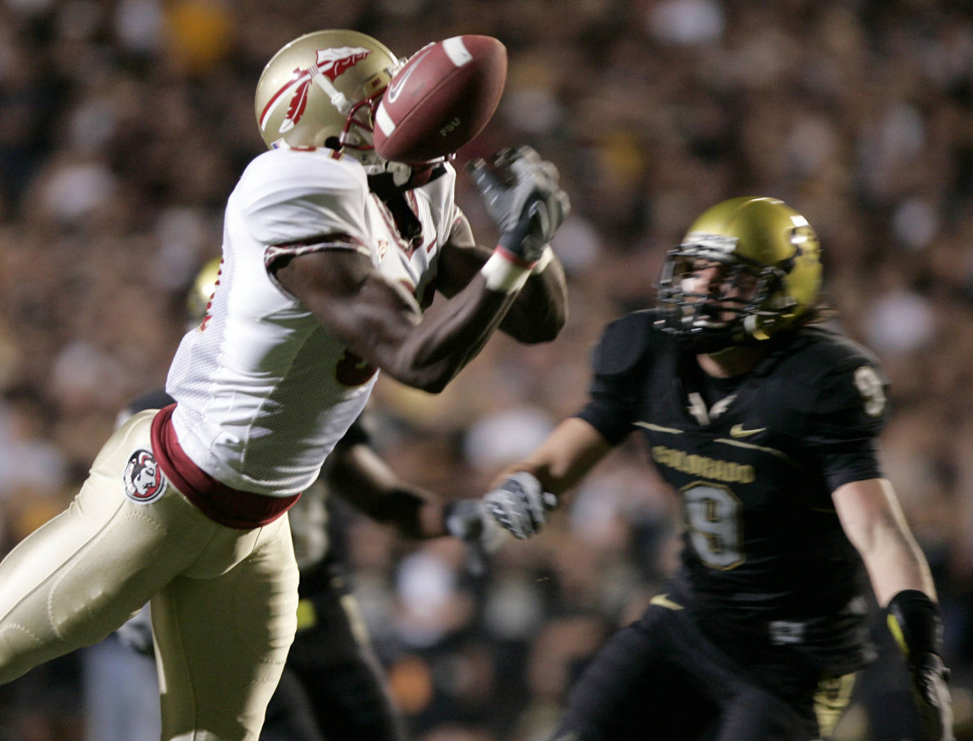 Florida State wide receiver De'Cody Fagg, front, drops a pass as Colorado safety Daniel Dykes looks on in the first quarter. (AP Photo/Jack Dempsey)