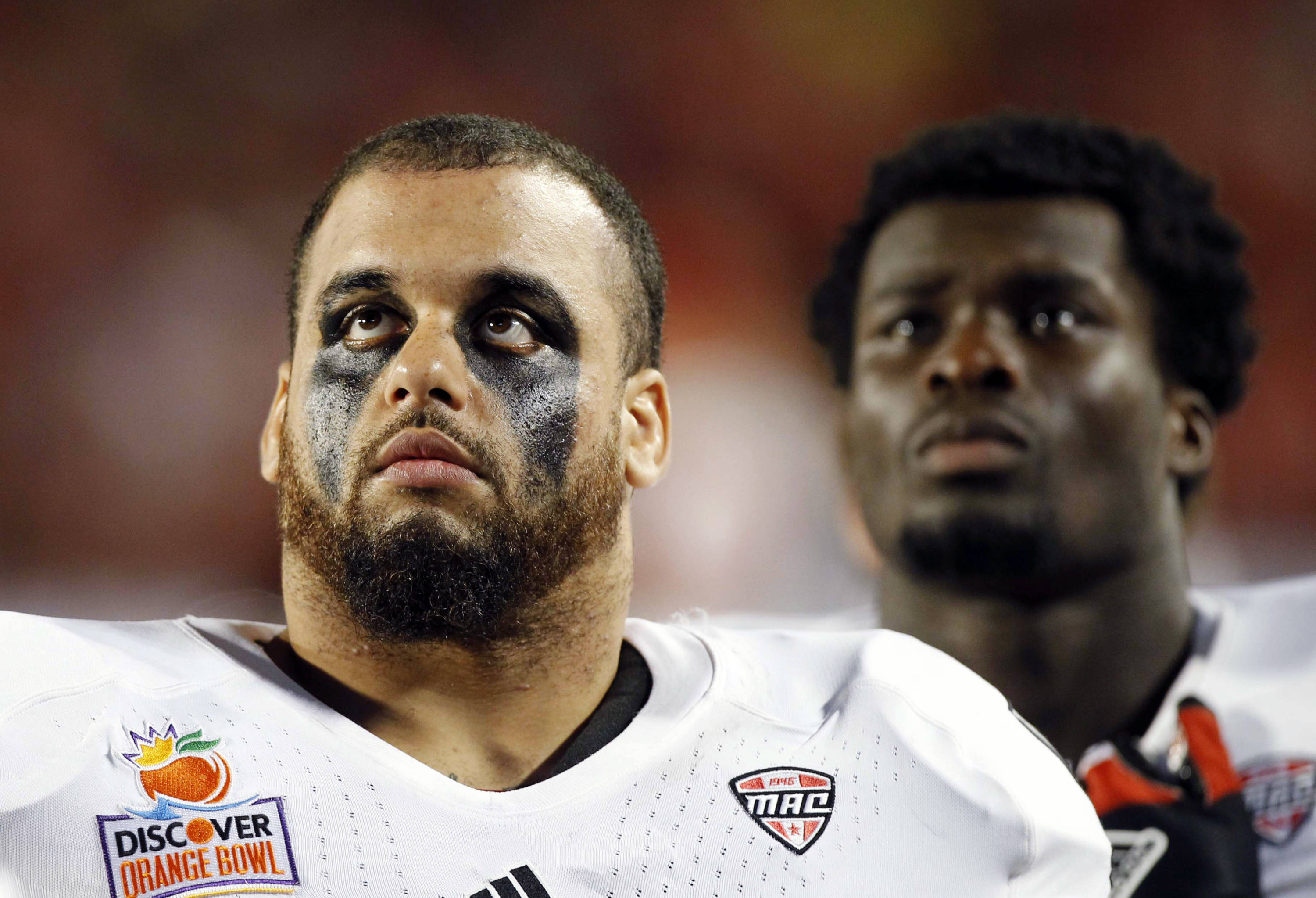 Northern Illinois defensive tackle Zach Anderson, left, and running back Perez Ford look up during the second half of the Orange Bowl NCAA college football game against Florida State, Tuesday, Jan. 1, 2013, in Miami. (AP Photo/Alan Diaz)