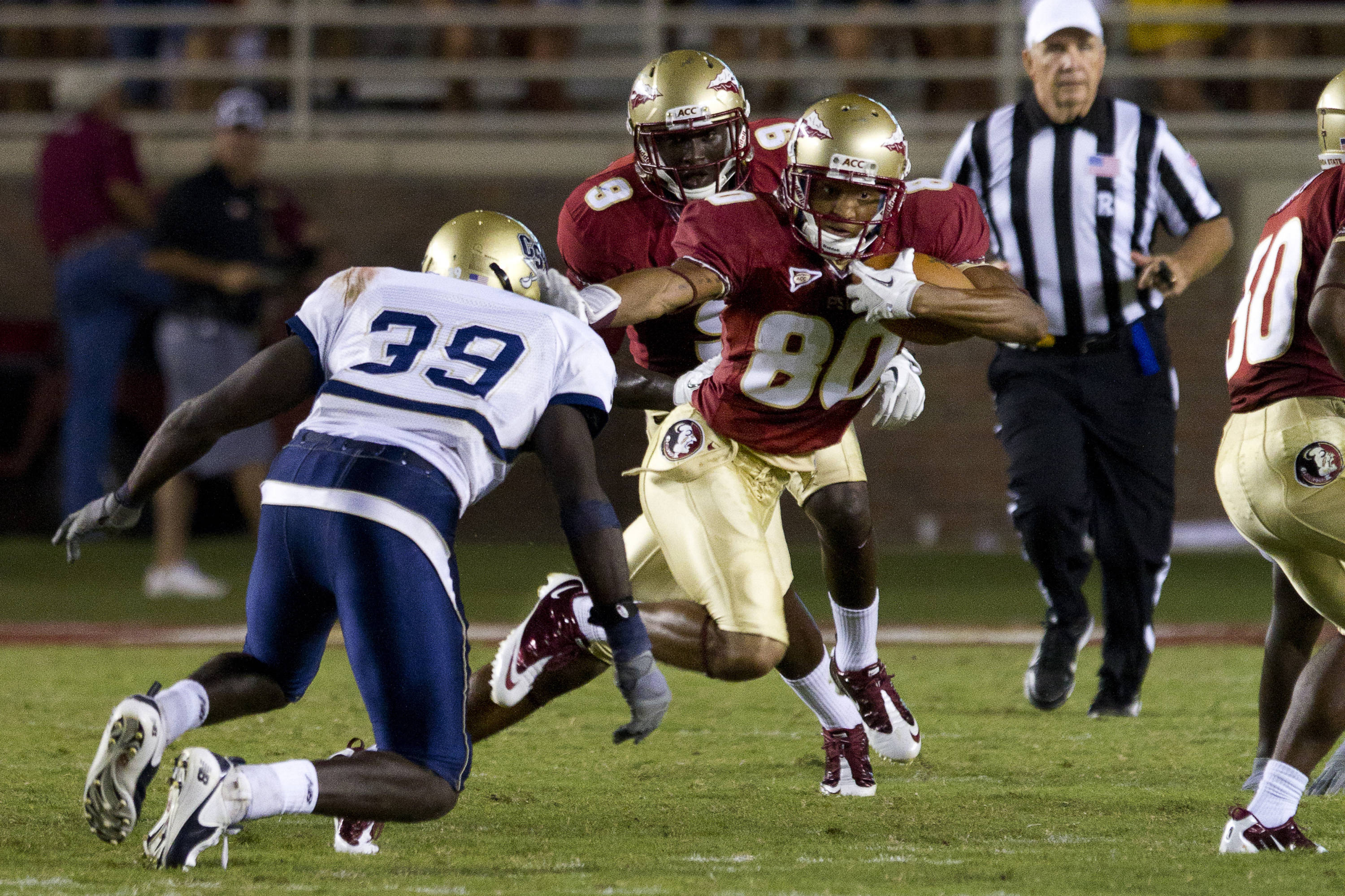 Rashad Greene (80) stiff arms a defender during the game against CSU on September 10, 2011.