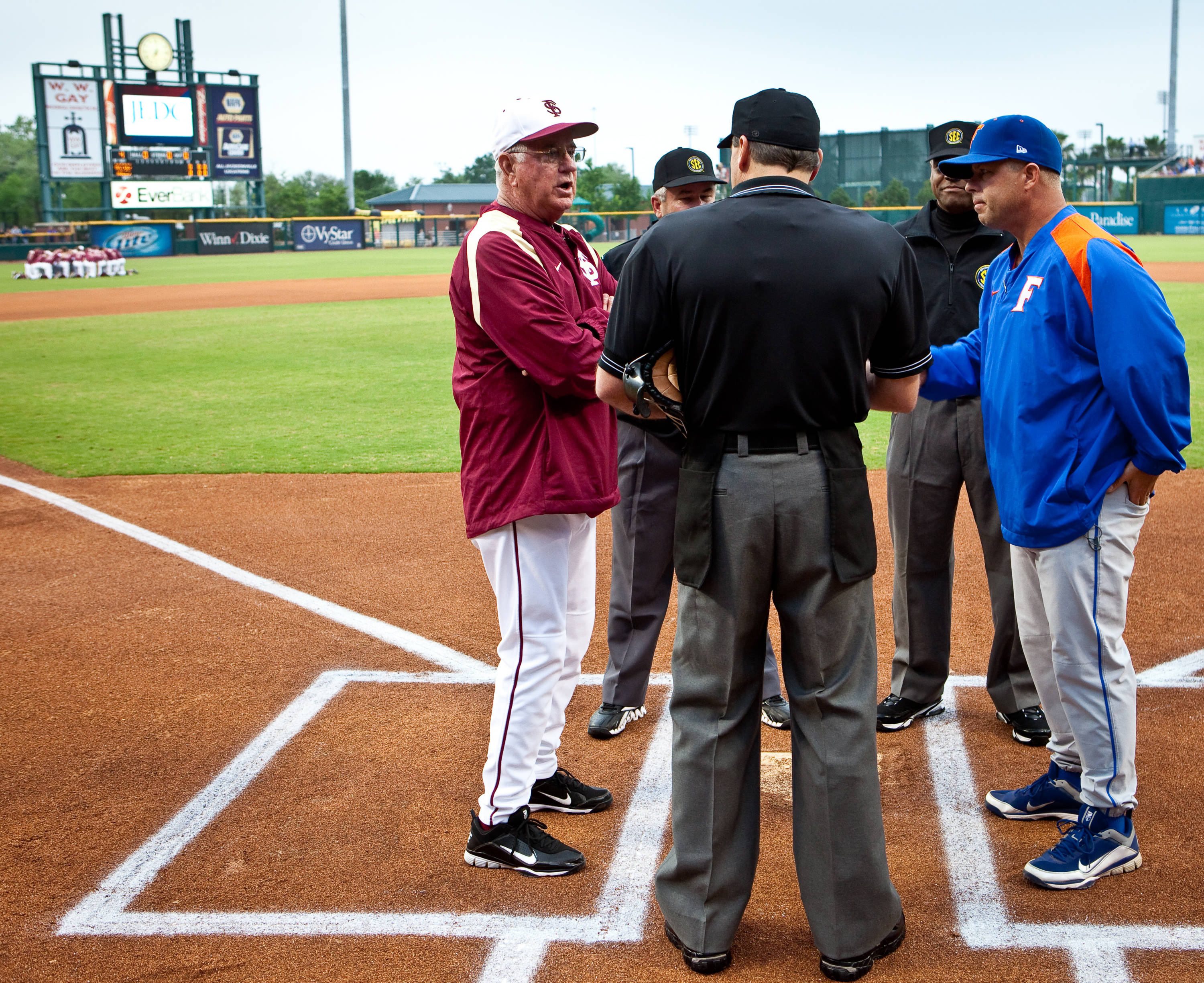 Mike Martin (11) and Florida head coach Kevin O'Sullivan meet at home plate