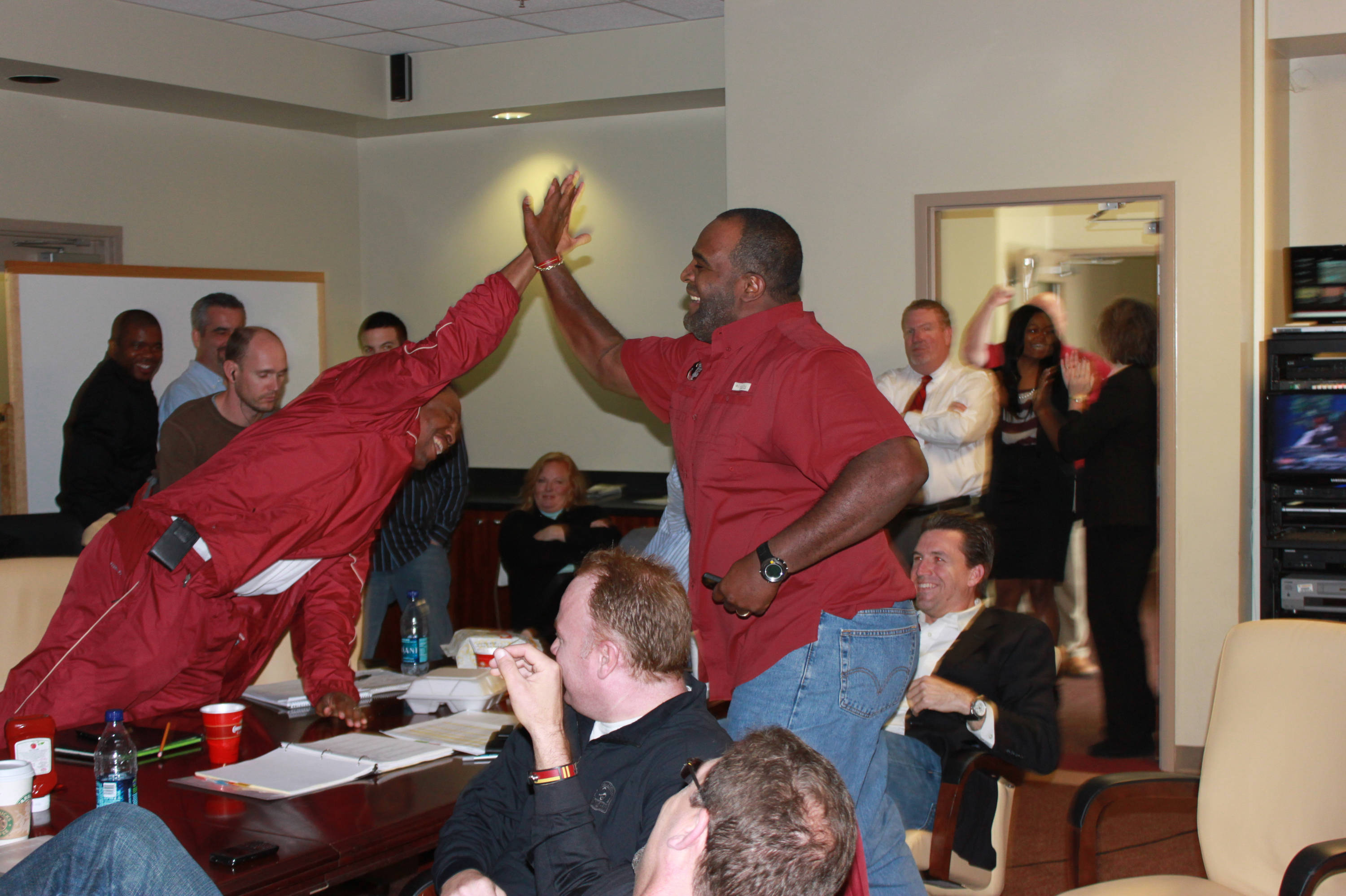 Odell Haggins high five's Lawrence Dawsey after Jernigan committed to FSU