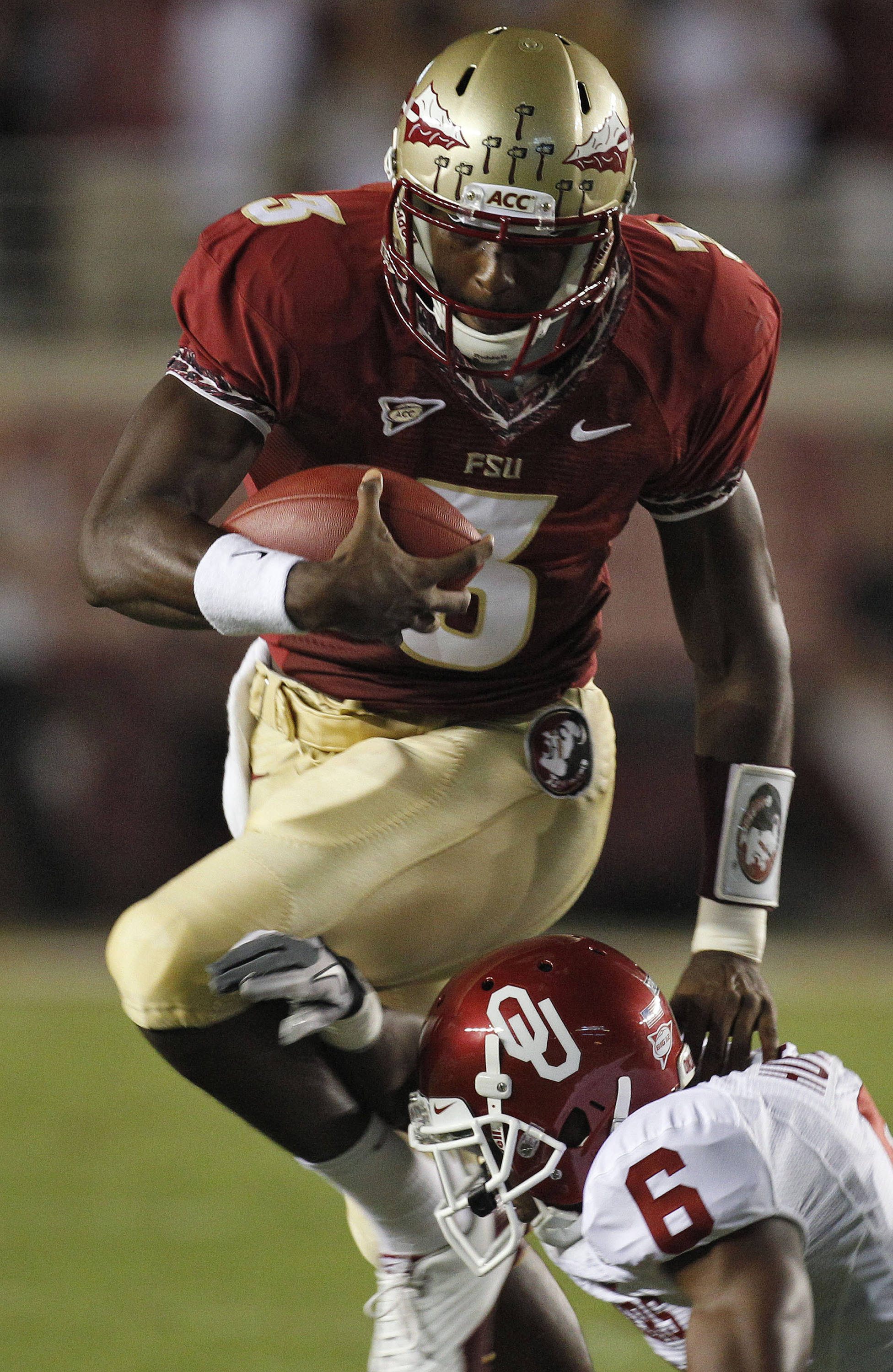 Oklahoma defensive back Demontre Hurst (6) attempts to take down Florida State quarterback EJ Manuel during the first quarter of an NCAA college football game, Saturday, Sept. 17, 2011, in Tallahassee, Fla. (AP Photo/Chris O'Meara)