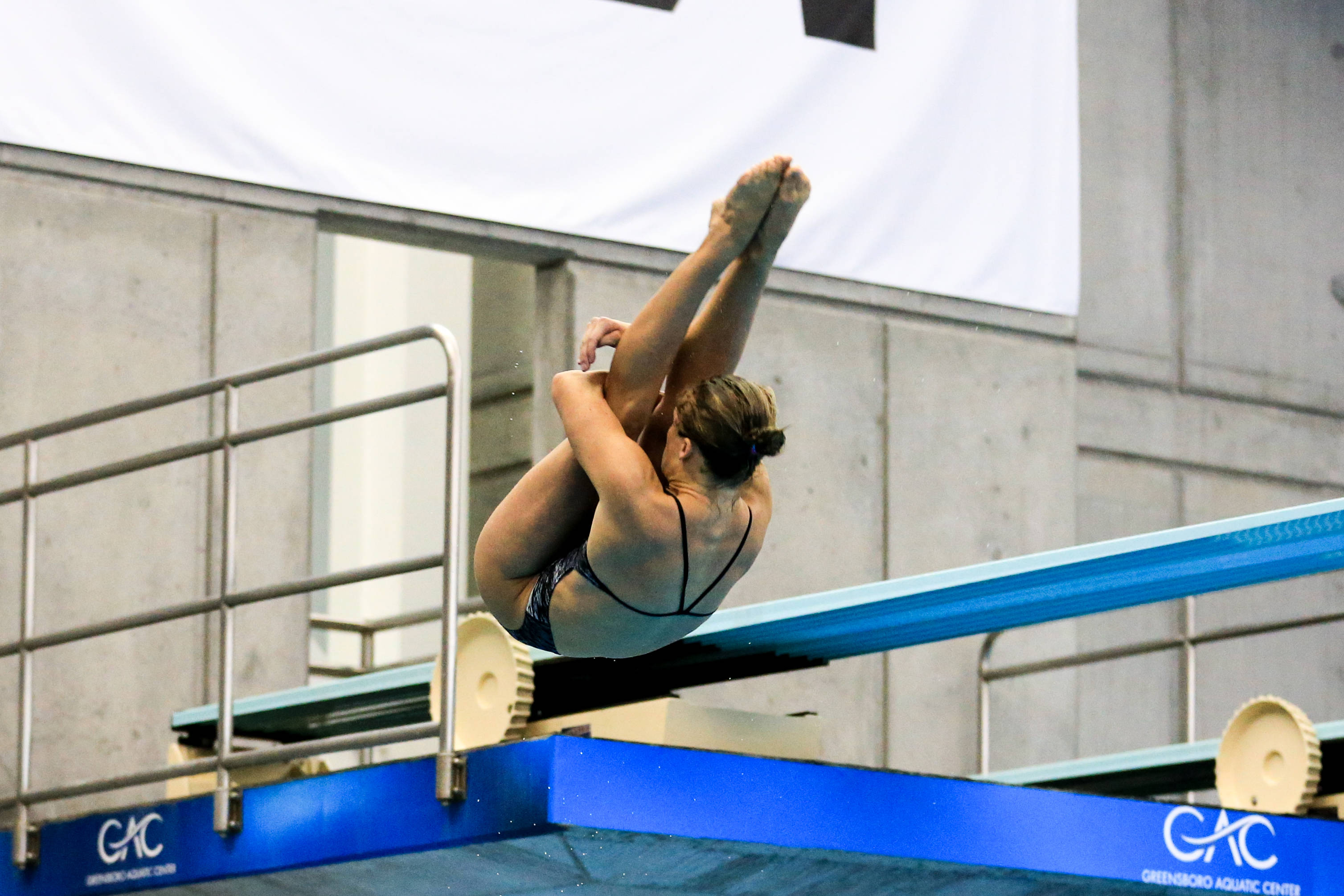 Katrina Young throws a back 1.5 in finals of 1-meter