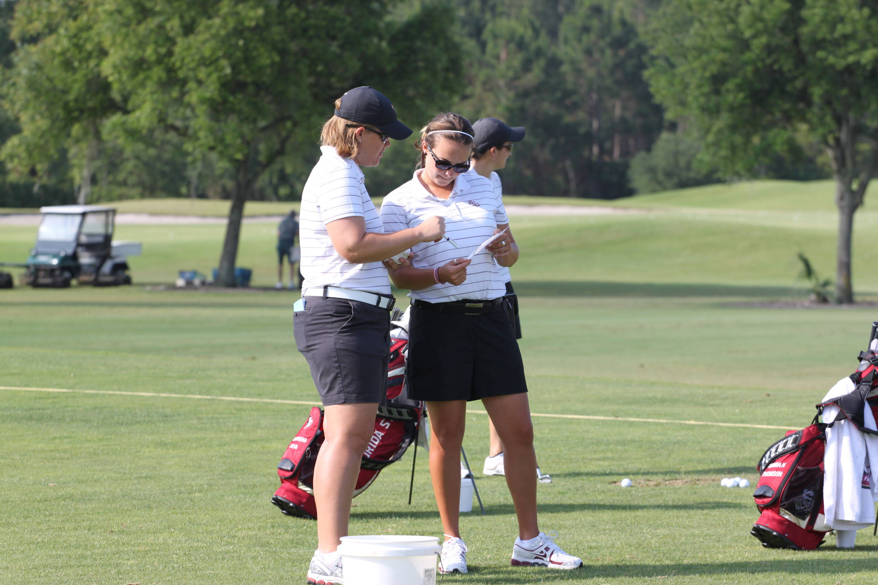 2011 NCAA Women's Golf - Head Coach Amy Bond and assistant coach Lindsay Koth prepare for the Seminoles' practice round.