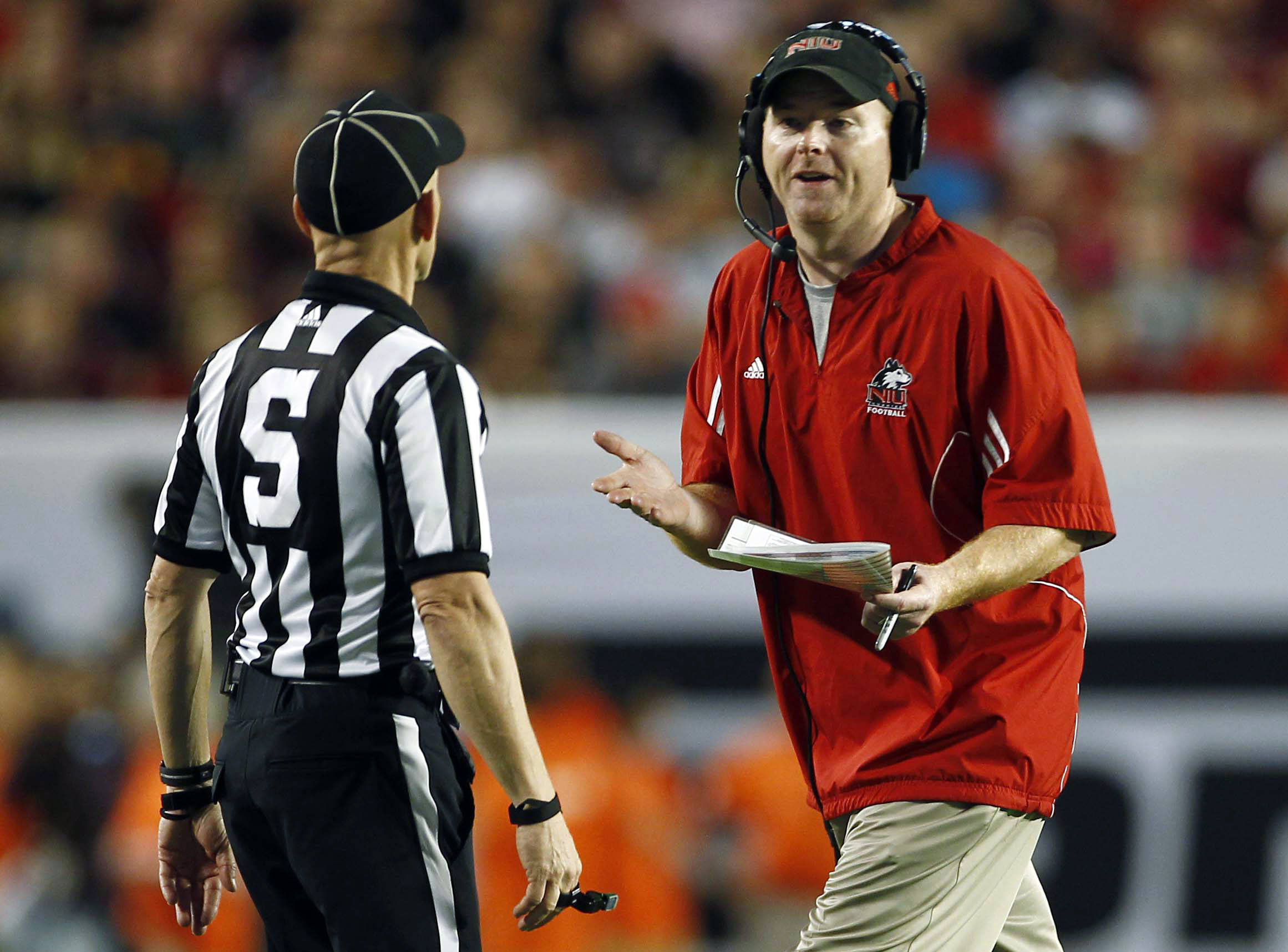 Northern Illinois head coach Rod Carey, right, argues a call with a referee during the first half of the Orange Bowl NCAA college football game against Florida State, Tuesday, Jan. 1, 2013, in Miami. (AP Photo/J Pat Carter)