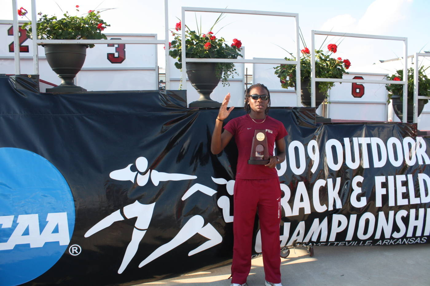 Kim Williams and her national championship award.