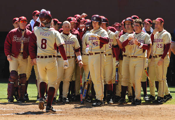 The Seminoles greet Buster Posey at home plate on his game tying, two-run home run in the fifth.