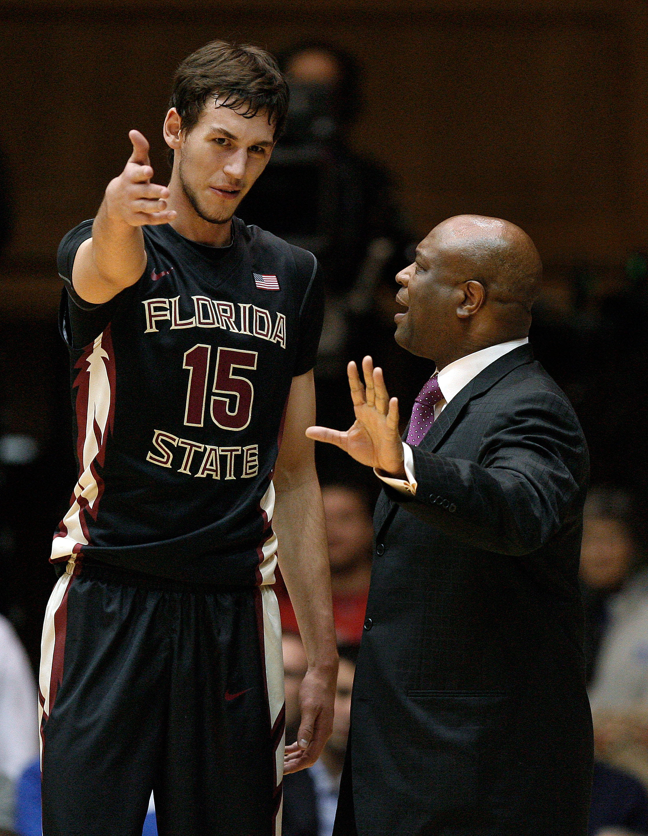 Jan 25, 2014; Durham, NC, USA; Seminoles head coach Leonard Hamilton talks to center Boris Bojanovsky (15) on the sidelines. Mark Dolejs-USA TODAY Sports