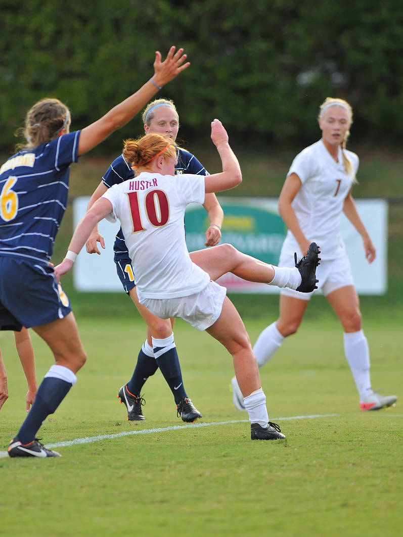 Tori Huster finds the back of the net for the first goal of the game in the eighth minute of play.