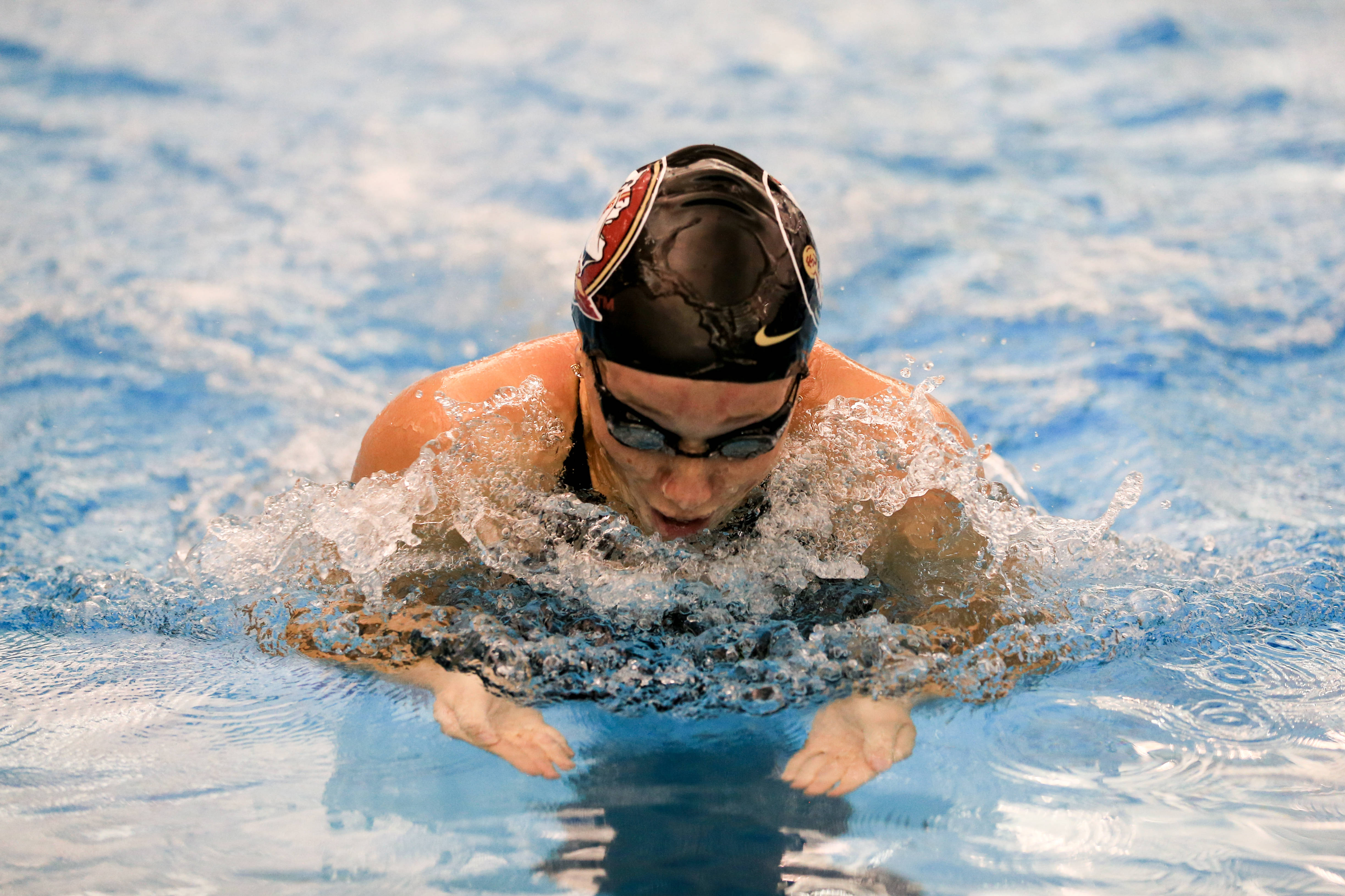 Natalie Pierce swims the breast leg of the 200 medley relay.