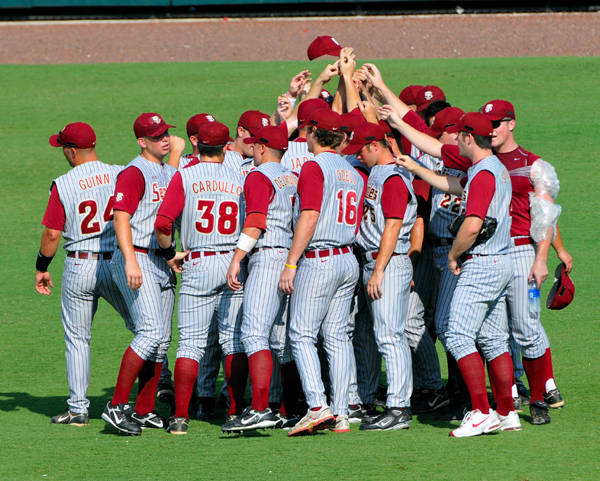 The Seminoles huddle before the start of game three against the Tar Heels.