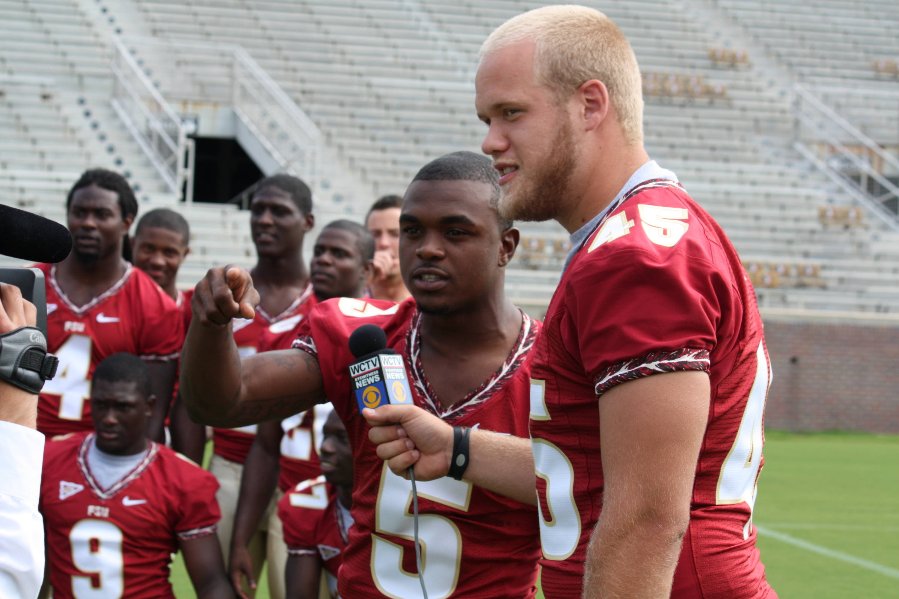 Greg Reid and Shawn Powell hamming it up in front of the camera.
