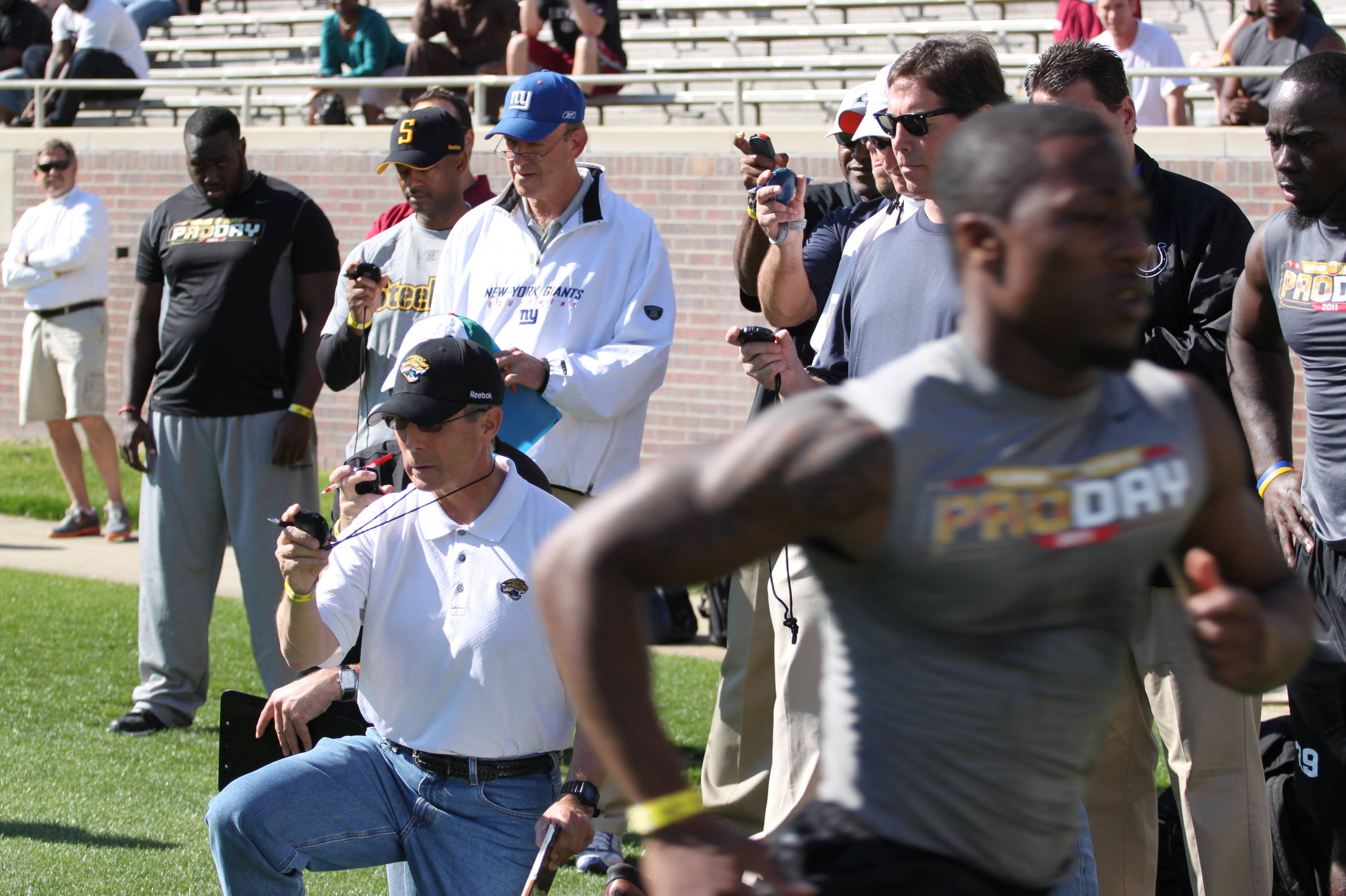 NFL scouts track and measure every drill at Pro Day.