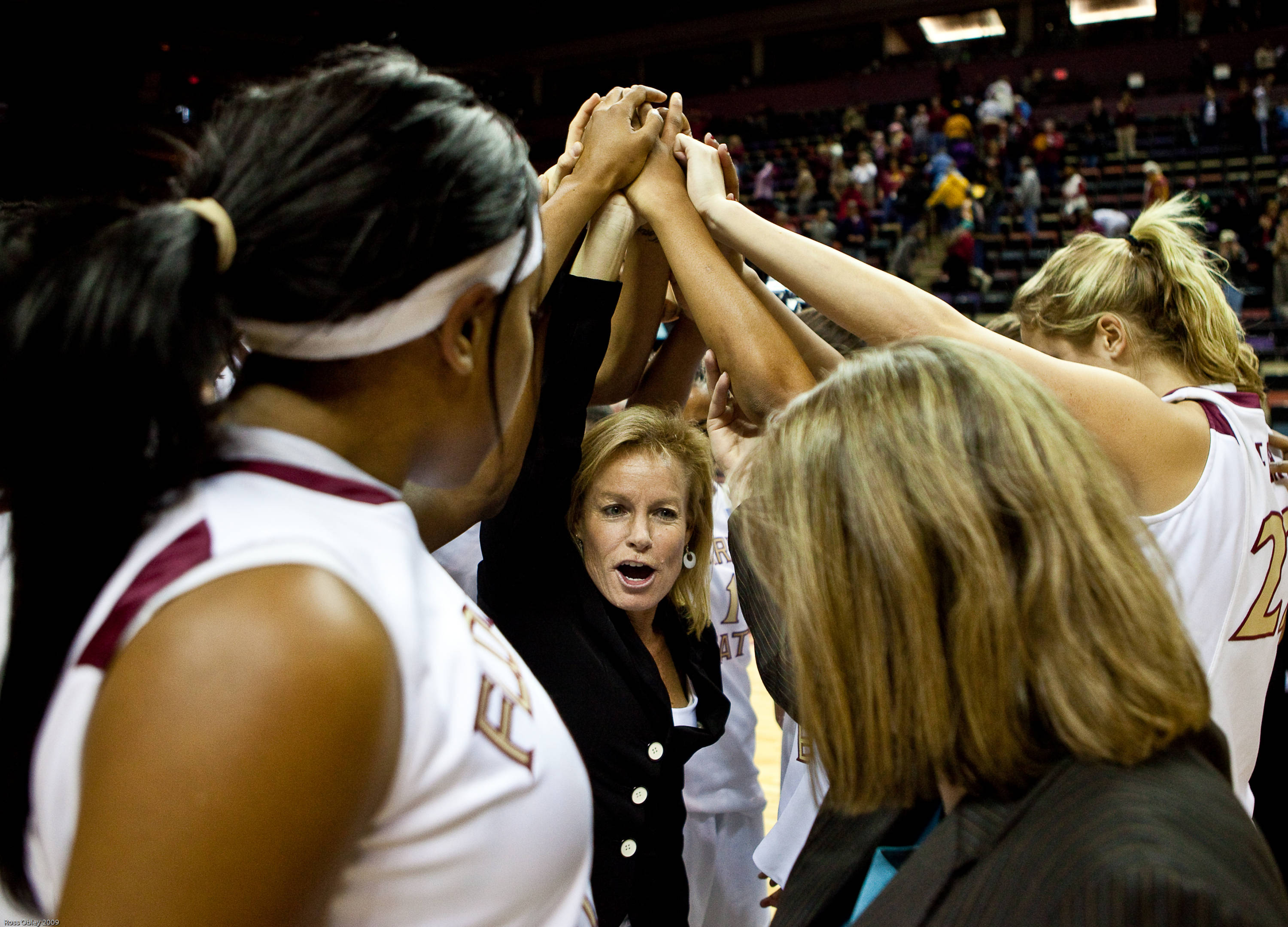 August 10 ... Head coach Sue Semrau and her team gathers in a huddle before a game last season against Virginia.