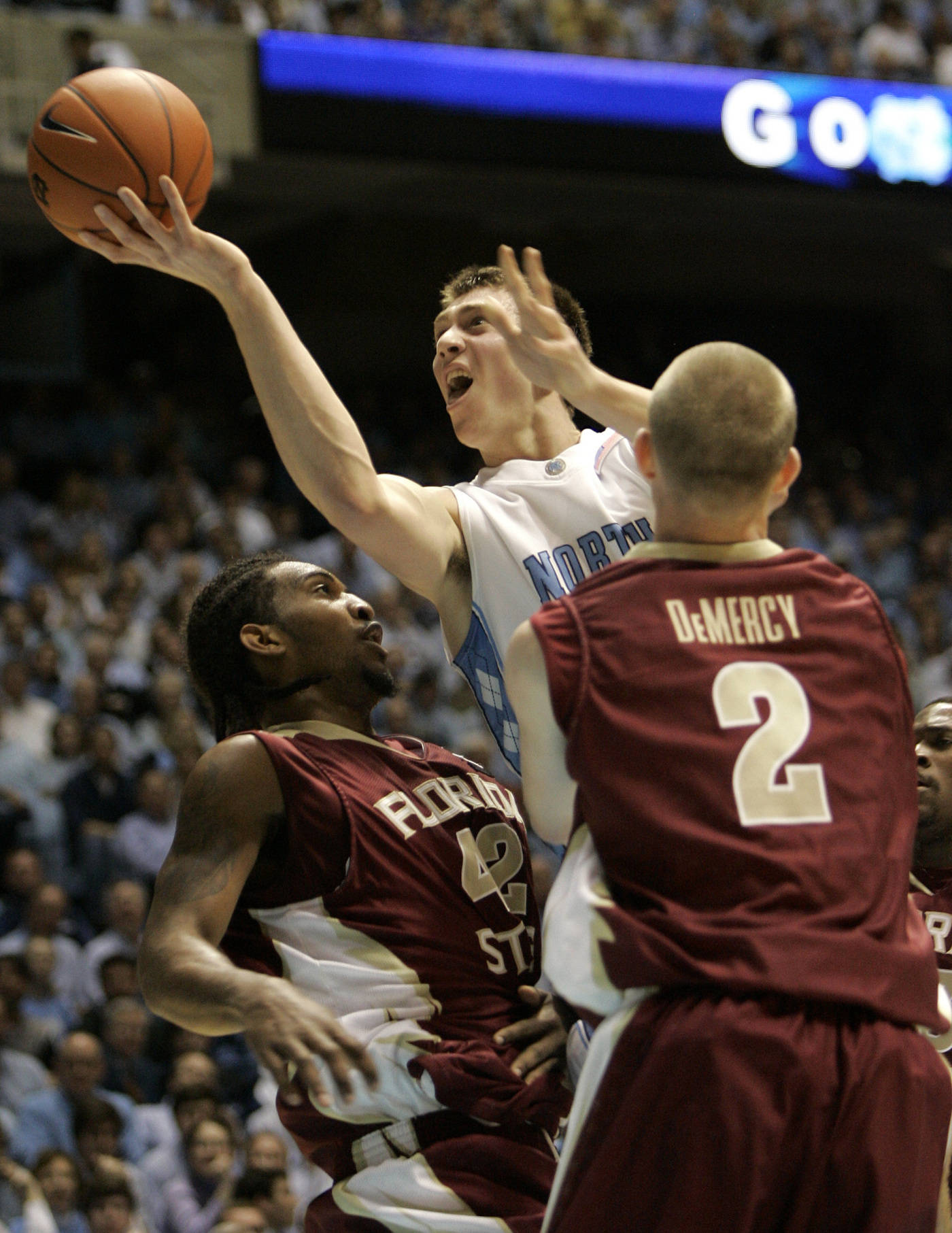 North Carolina's Tyler Hansbrough, center, drives between Florida State's Ryan Reid (42) and Jordan DeMercy (2) during the first half of a college basketball game in Chapel Hill, N.C., Tuesday, March 4, 2008. (AP Photo/Gerry Broome)