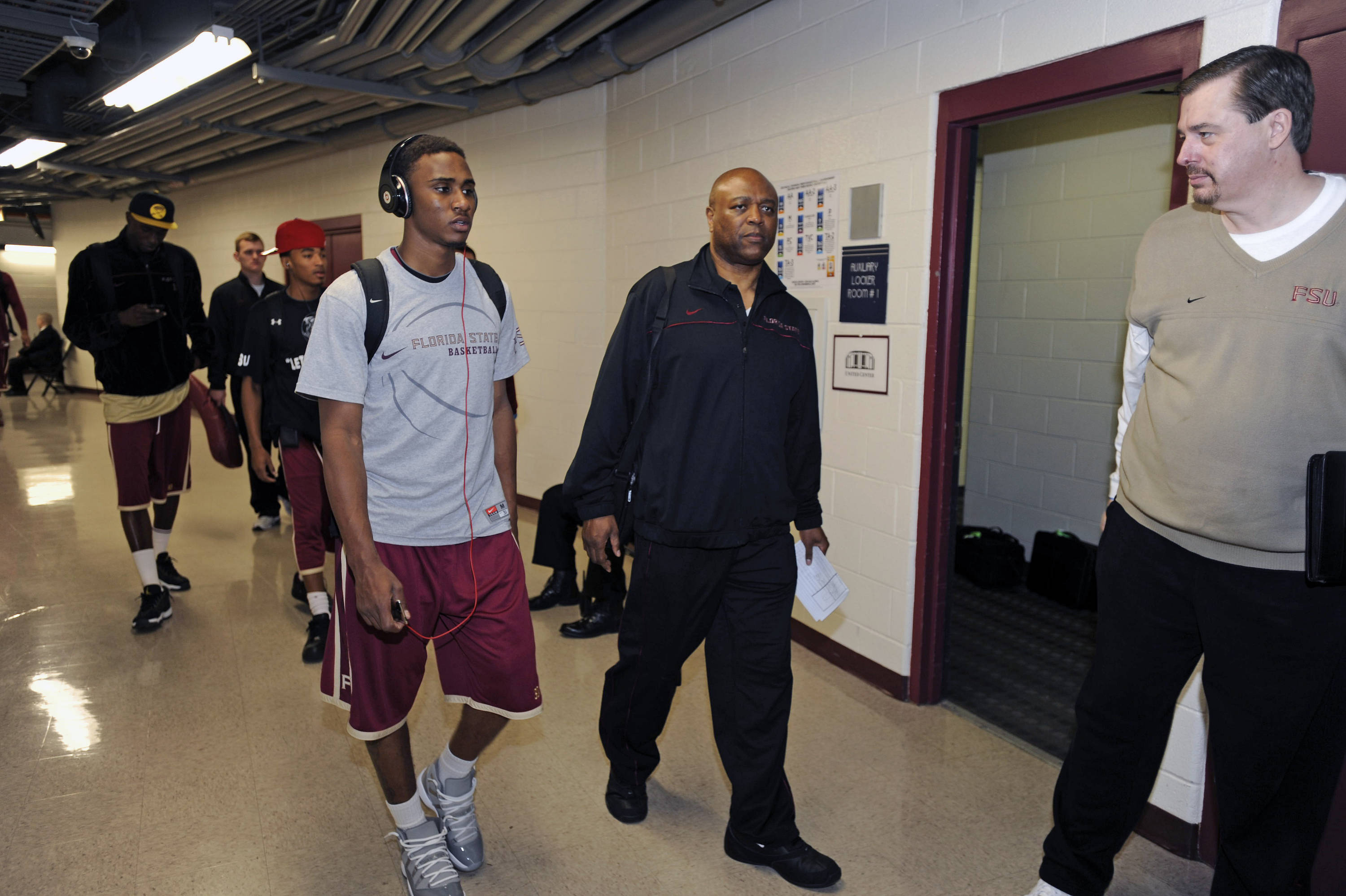 Ian Miller, Leonard Hamilton and Stan Jones walking the halls at the United Center
