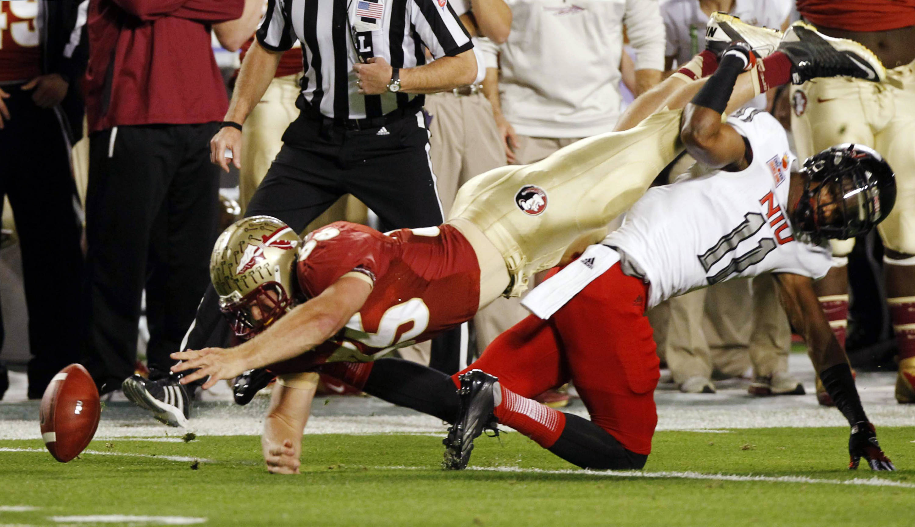 Florida State tight end Nick O'Leary (35) fumbles the ball as Northern Illinois cornerback Rashaan Melvin (11) defends during the first half of the Orange Bowl NCAA college football game, Tuesday, Jan. 1, 2013, in Miami. The ball was recovered by Northern Illinois. (AP Photo/Alan Diaz)