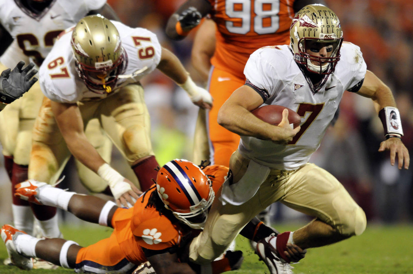 Florida State's quarterback Christian Ponder (7) gets taken down by Clemson's Jamie Cumble (8) during the first half. (AP Photo/Richard Shiro)