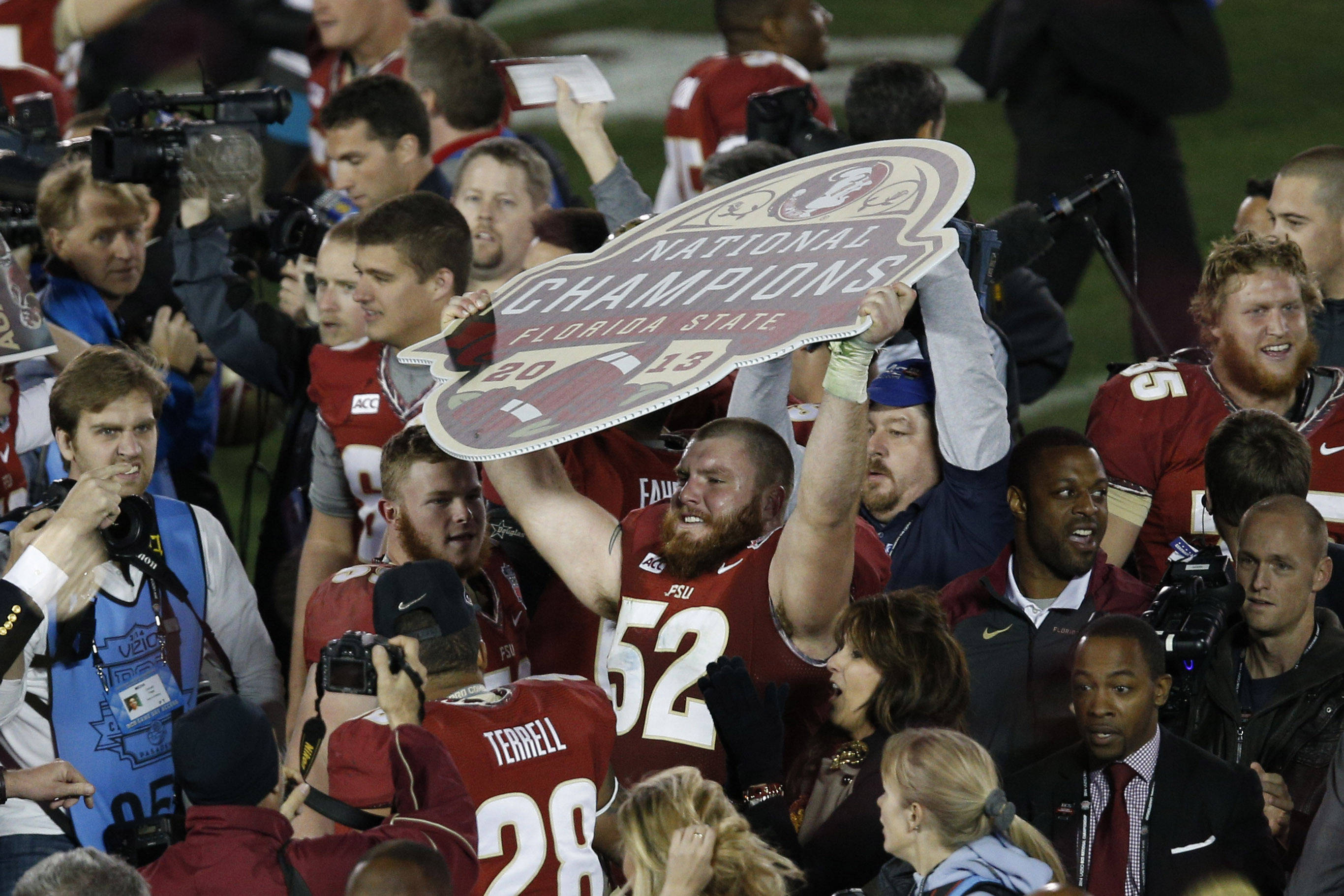 Jan 6, 2014; Pasadena, CA, USA; Florida State Seminoles offensive linesman Bryan Stork (52) celebrates after the 2014 BCS National Championship game against the Auburn Tigers at the Rose Bowl.  Mandatory Credit: Kelvin Kuo-USA TODAY Sports