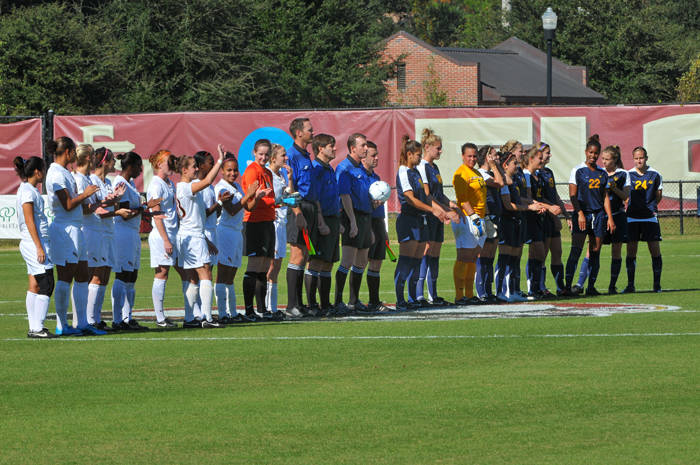 Florida State and California players line up during pre-game introductions.