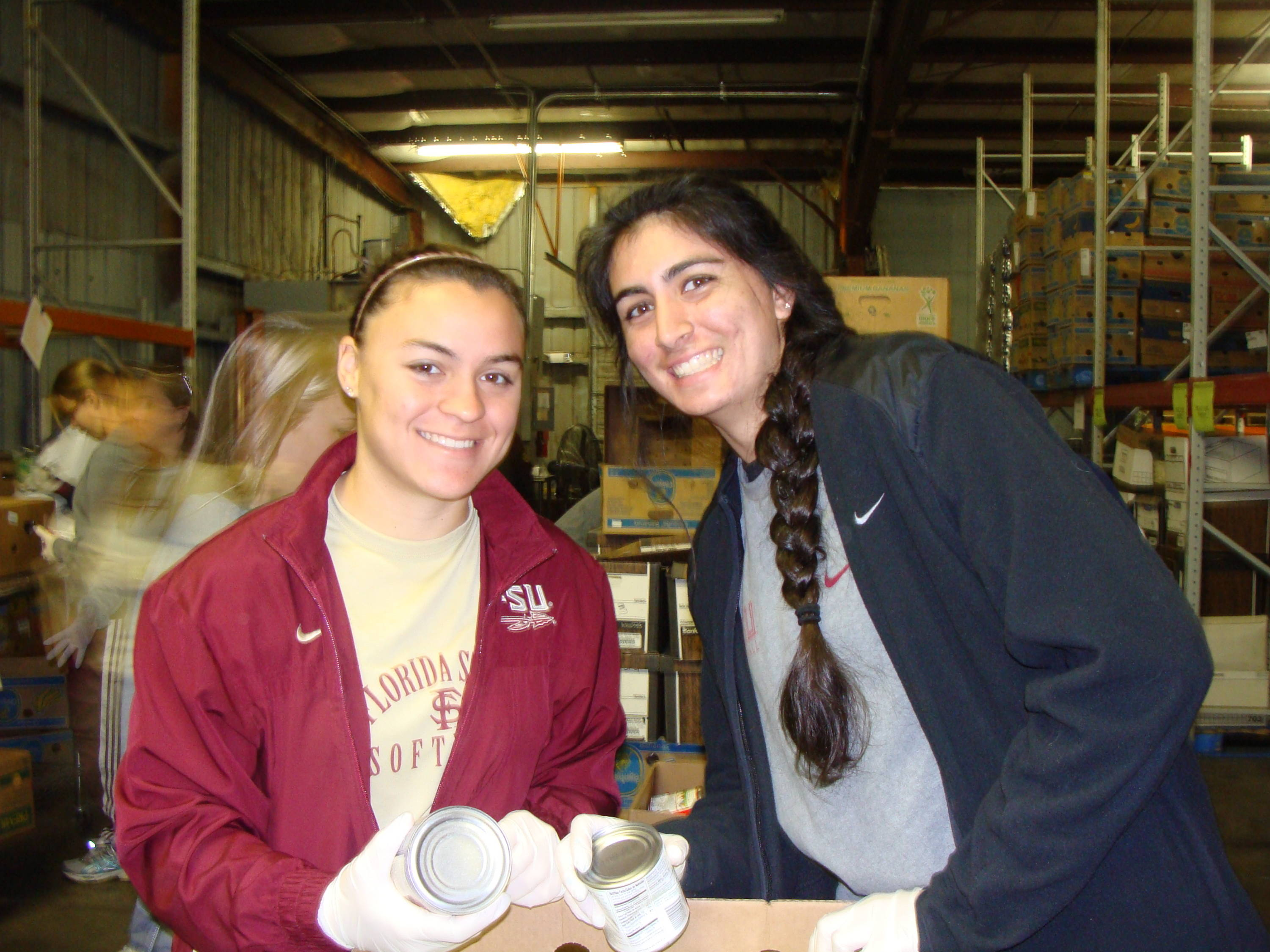 Celeste Gomez (00), Jessica Nori (26) collect canned goods for the Holiday Food Drive