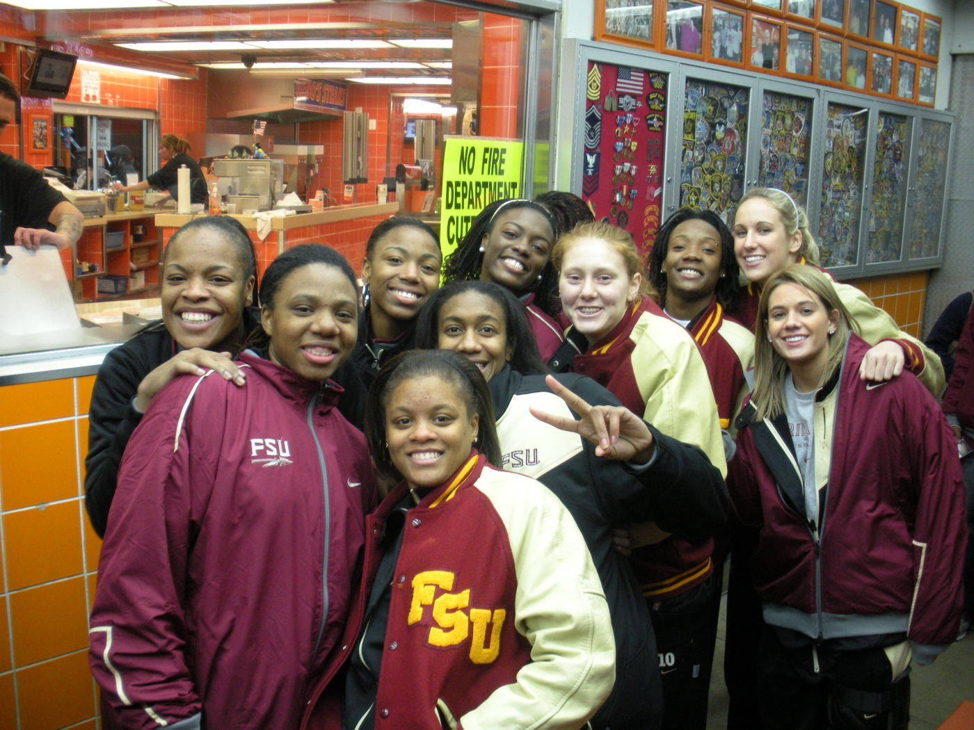 FS players were all smiles as they braved snowy conditions while waiting in line for a world-famous Philly cheesesteak.