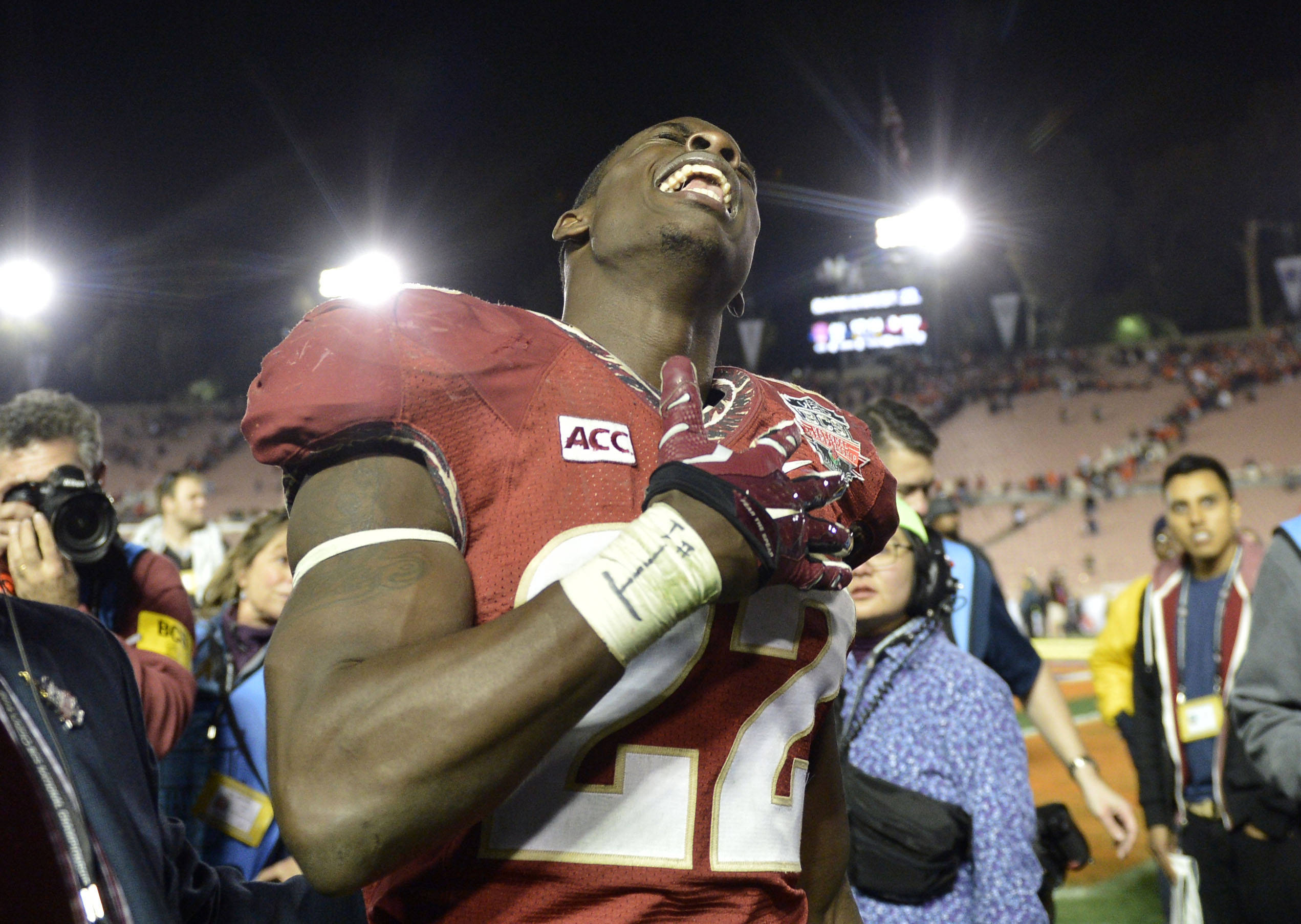 Jan 6, 2014; Pasadena, CA, USA; Florida State Seminoles linebacker Telvin Smith (22) celebrates after the 2014 BCS National Championship game against the Auburn Tigers at the Rose Bowl.  Mandatory Credit: Robert Hanashiro-USA TODAY Sports