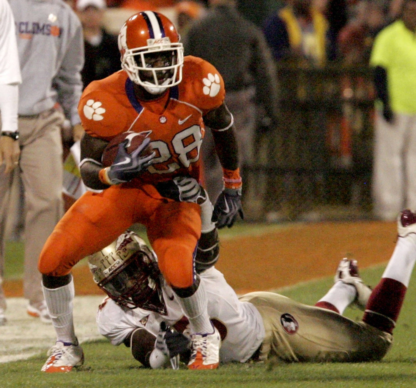 Clemson's C.J.Spiller (28) runs for a first down as Florida State's Nigel Bradham (13) defends during the first half. (AP Photo/Mary Ann Chastain)