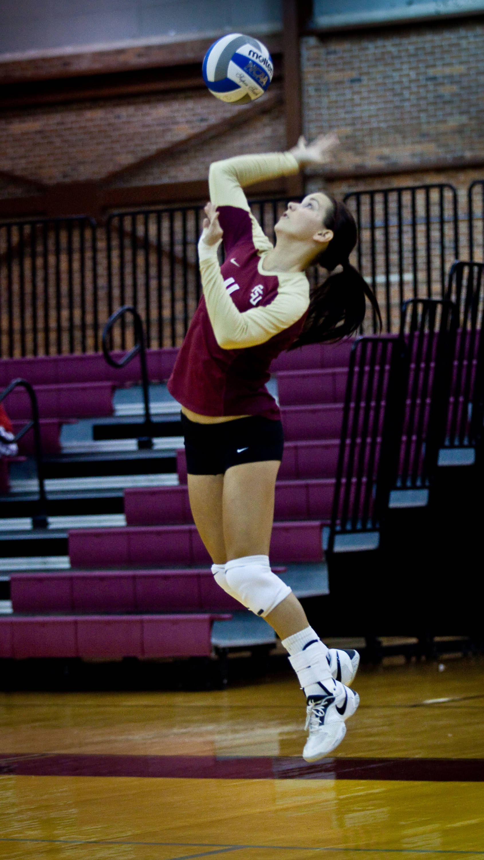 Kalee Schlabach (11) goes up for a serve