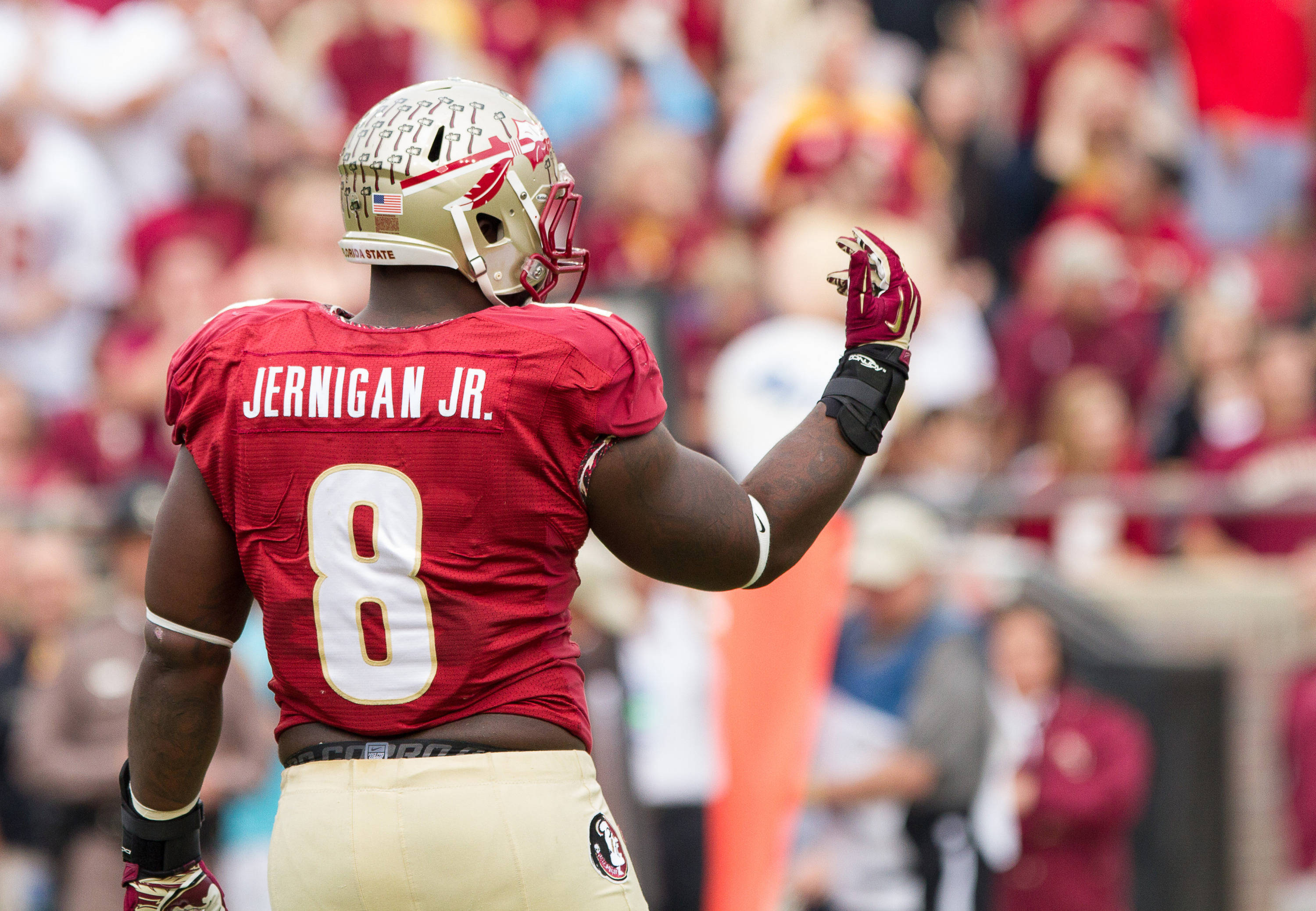 Timmy Jernigan (8) beckons the team back after an Idaho run is taken back as a result of a holding penalty during FSU Football's 80-14 victory over Idaho in Tallahassee, Fla on Saturday, November 23, 2013. Photos by Mike Schwarz.