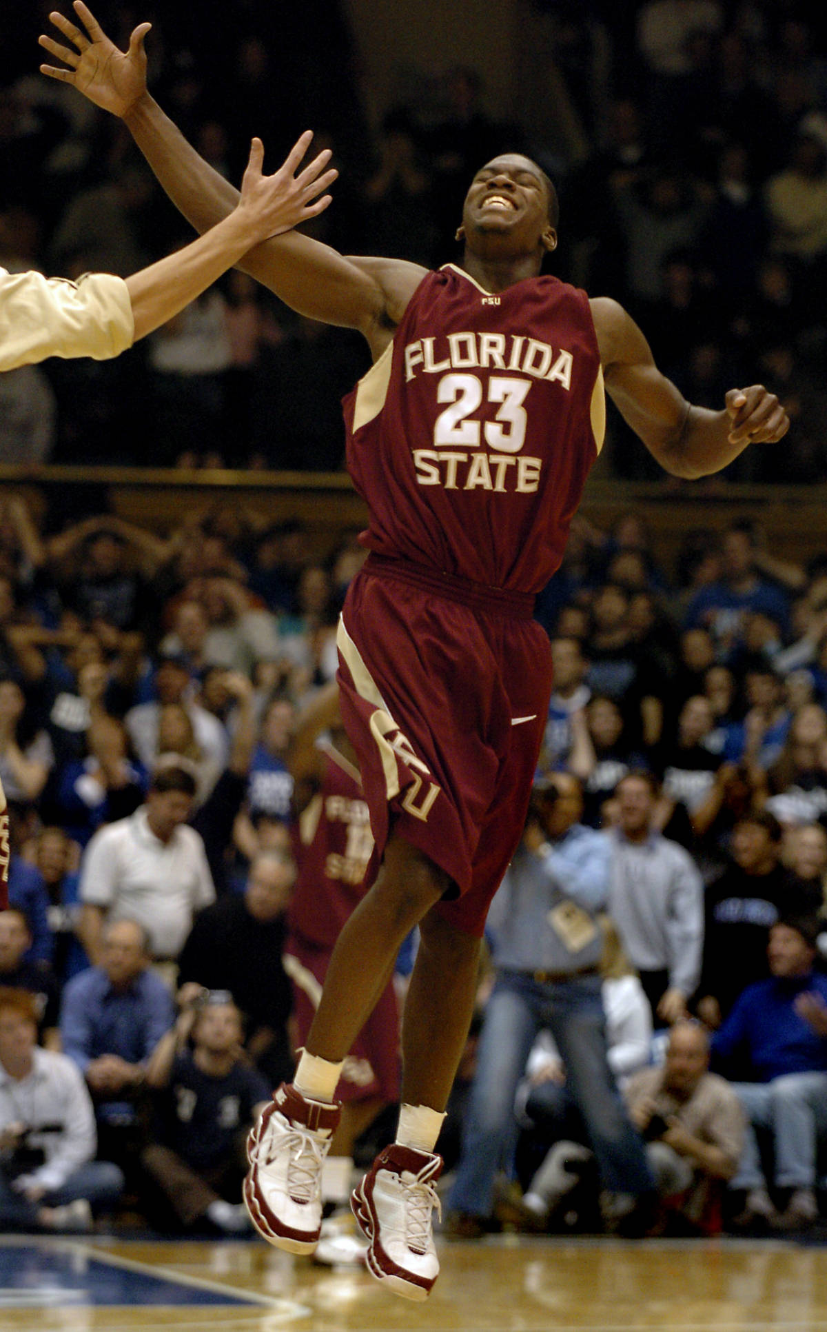Florida State's Toney Douglas (23) celebrates their 68-67 win over No. 10 Duke at a basketball game in Durham, N.C., on Sunday, Feb. 4, 2007. (AP Photo/Sara D. Davis)